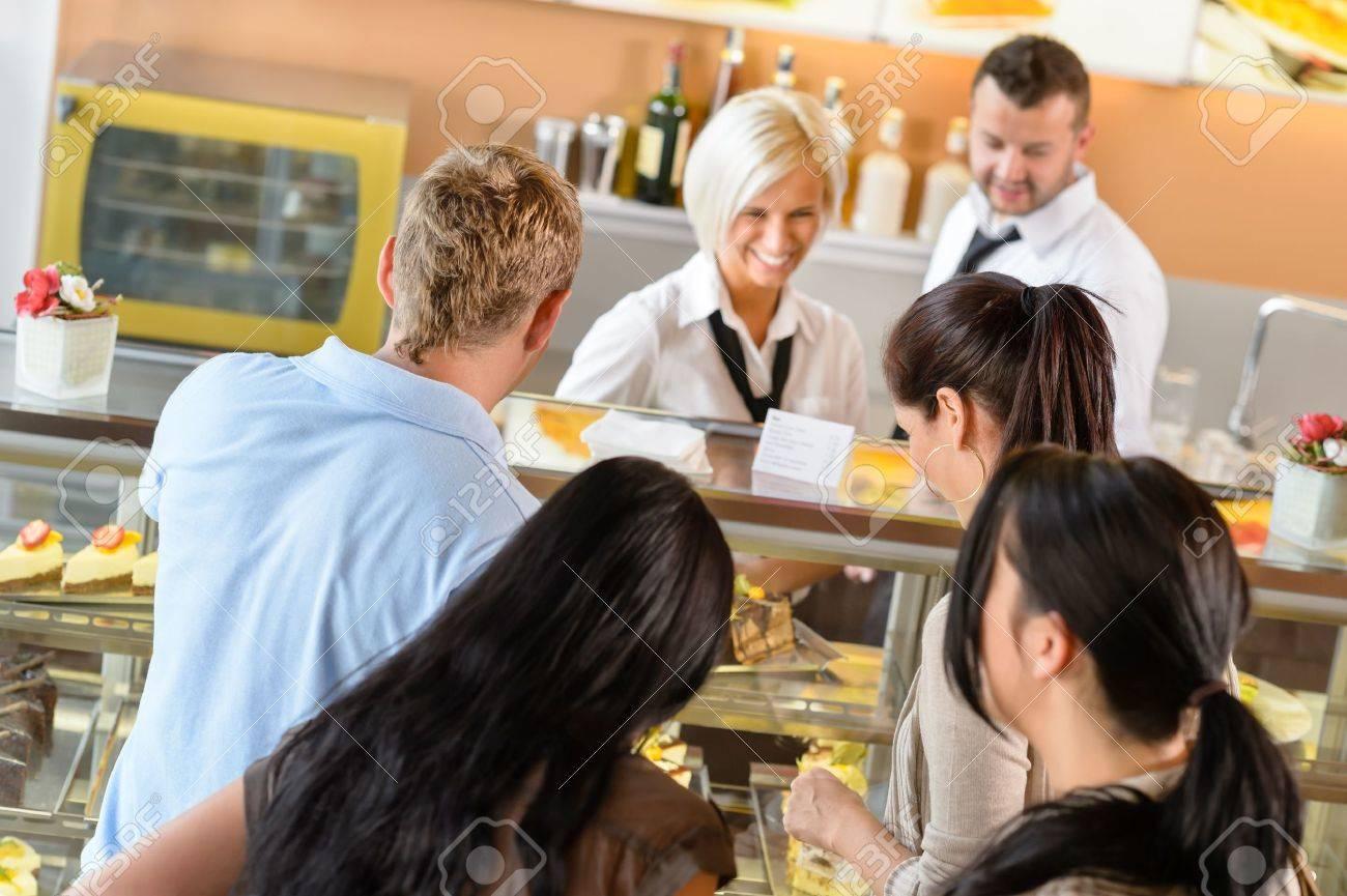 People buying cakes at cafe bar queue women  display dessert Stock Photo - 15501033