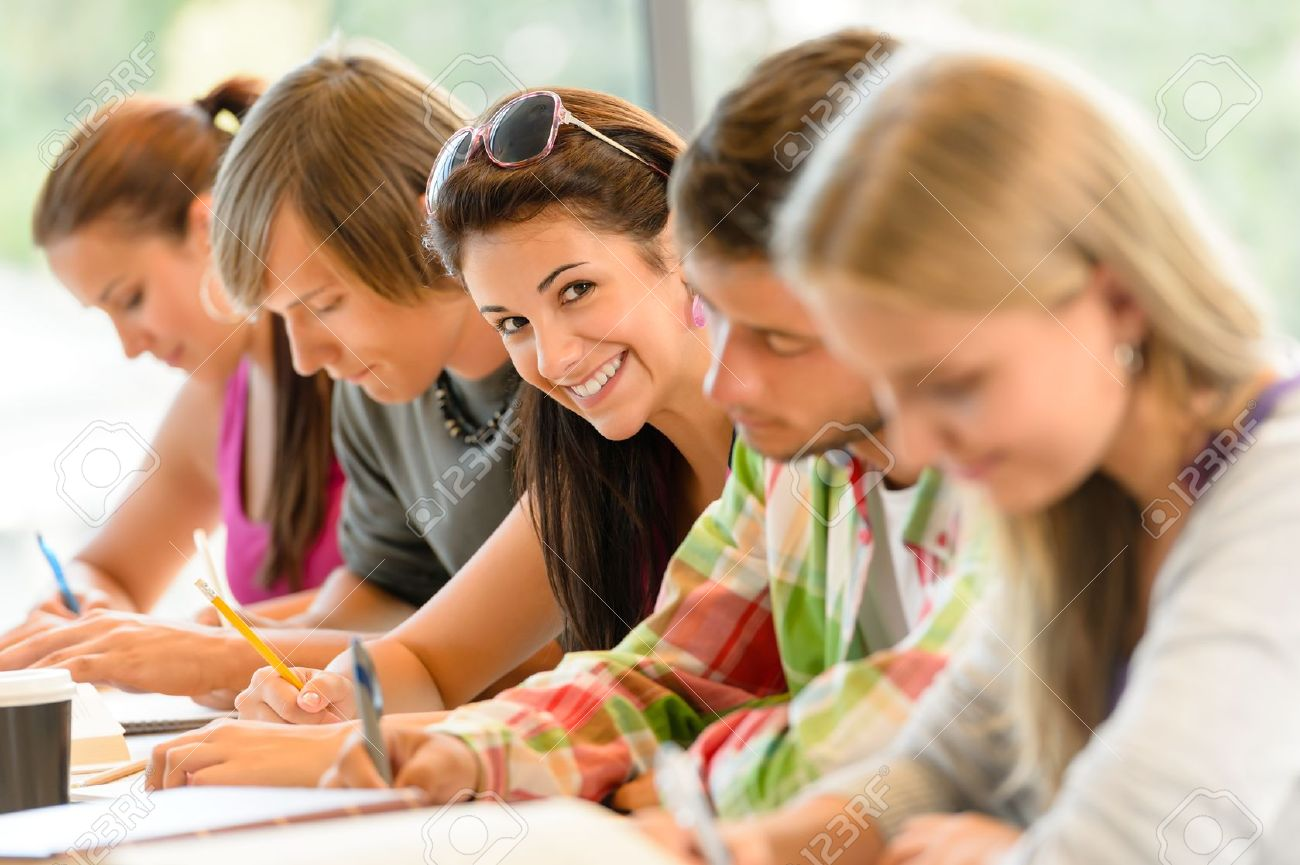 students writing at high-school exam teens study campus academic