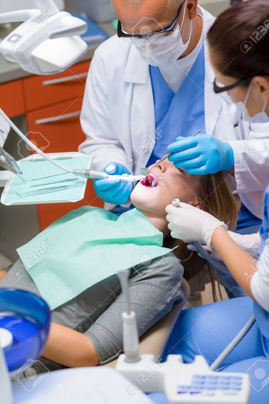 Woman at dentist surgery having dental checkup professional tools Stock Photo - 15310223