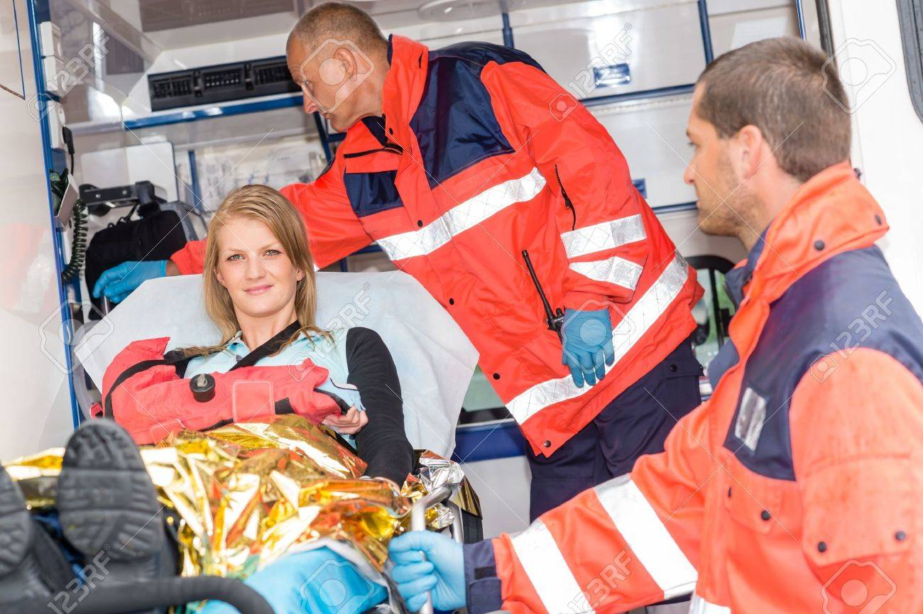 Woman with broken arm in ambulance paramedics accident helping victim Stock Photo - 15335907