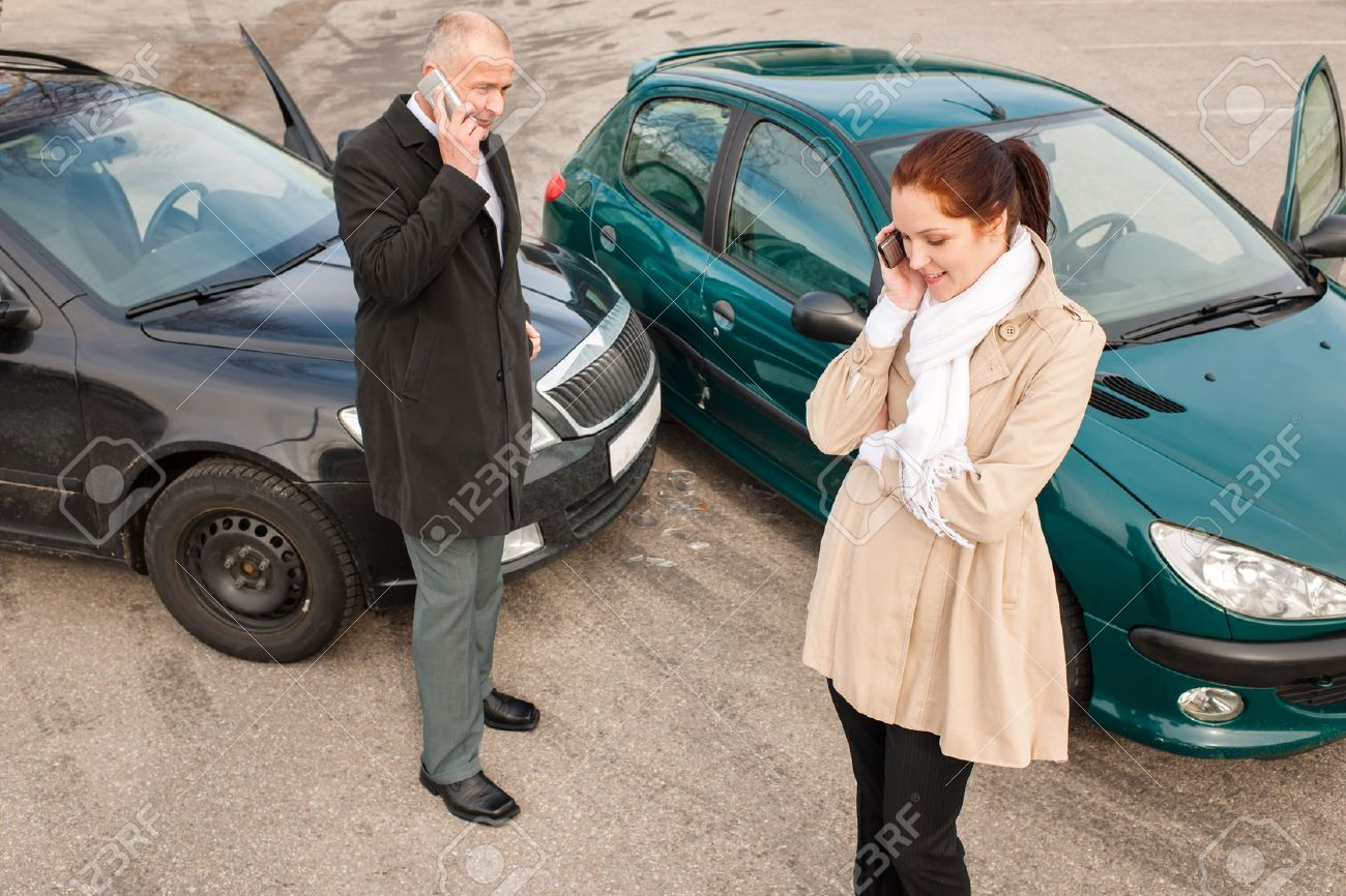 Woman and man on phone car crash accident calling problem Stock Photo - 15424573