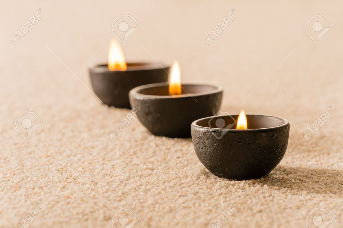 Spa therapy three candles on sand still nature Stock Photo - 15588847
