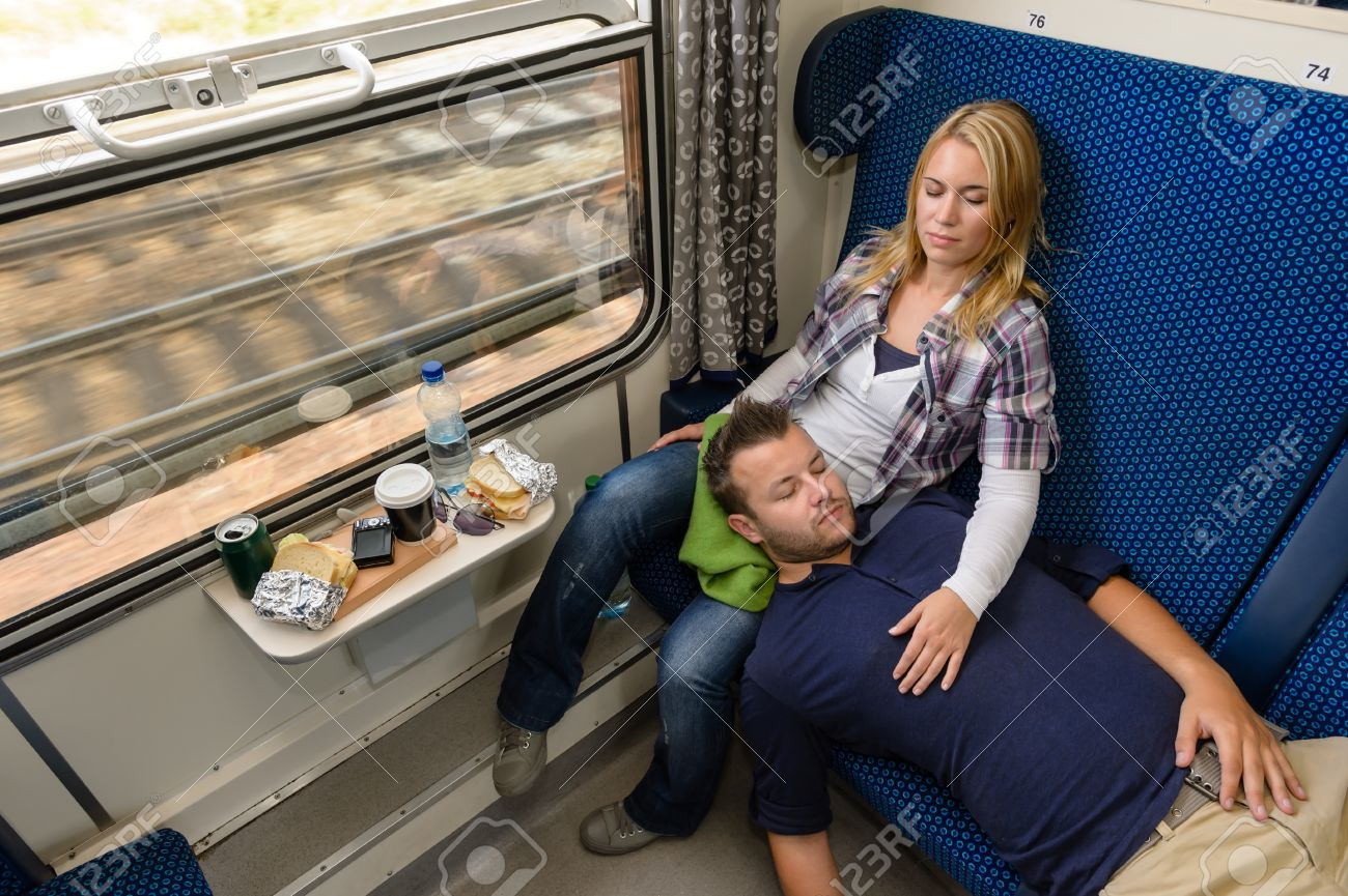 Couple sleeping while traveling with train tired man woman resting Stock Photo - 16968400