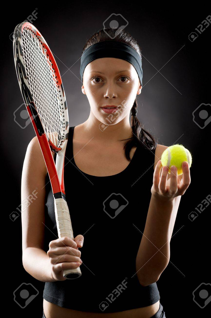 Female tennis player with racket and balll on black background Stock Photo - 16969615