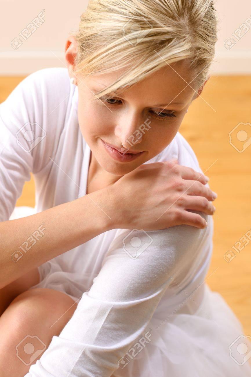 Beautiful ballerina rests sitting on studio floor woman ballet happy Stock Photo - 16984860