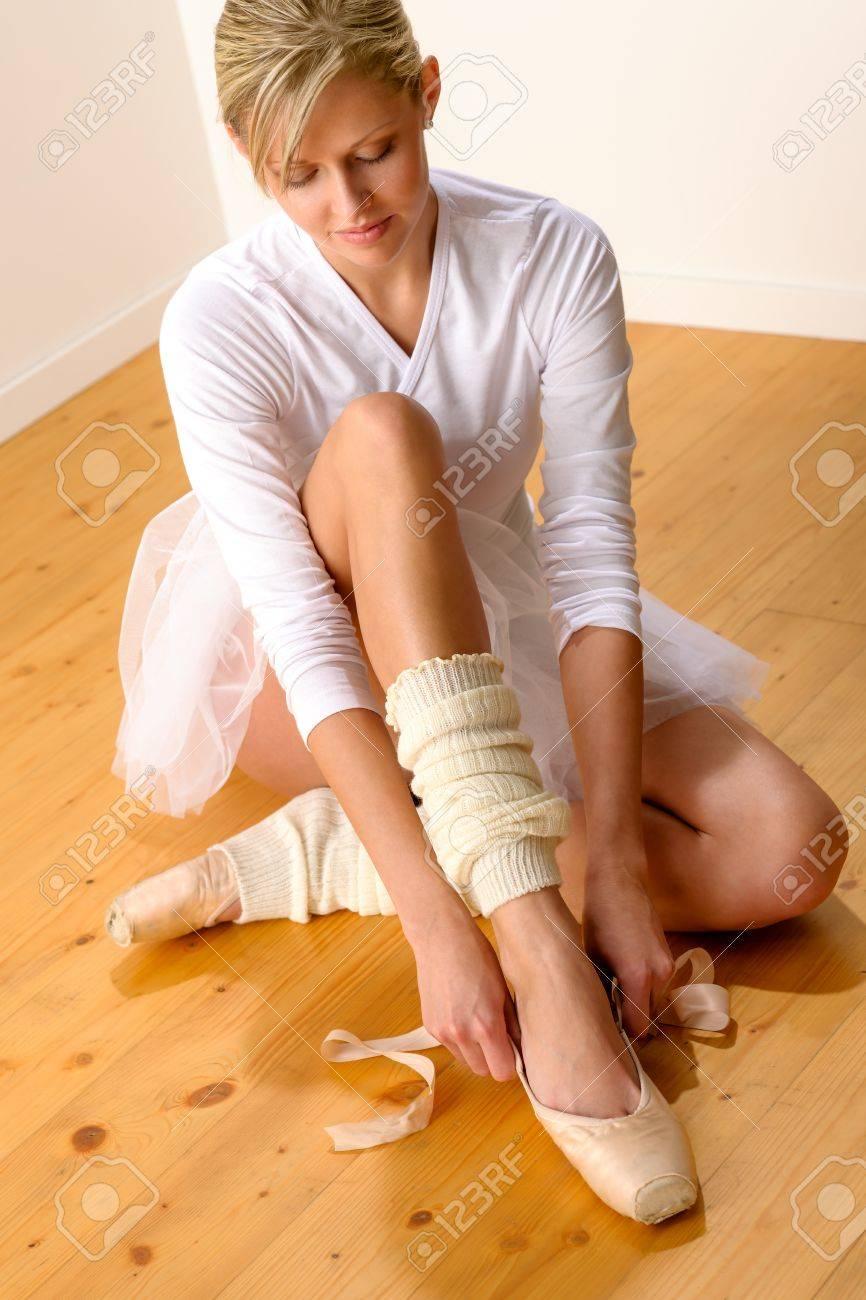 Ballet dancer getting ready for studio performance woman ballerina dressing Stock Photo - 16984854