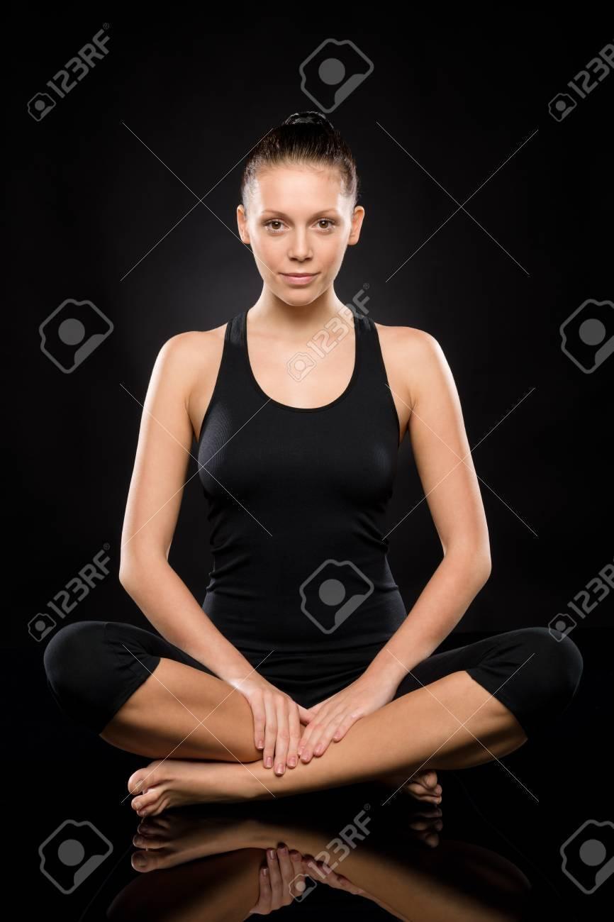 Young Caucasian woman doing yoga legs crossed meditating relaxing pose Stock Photo - 17160276
