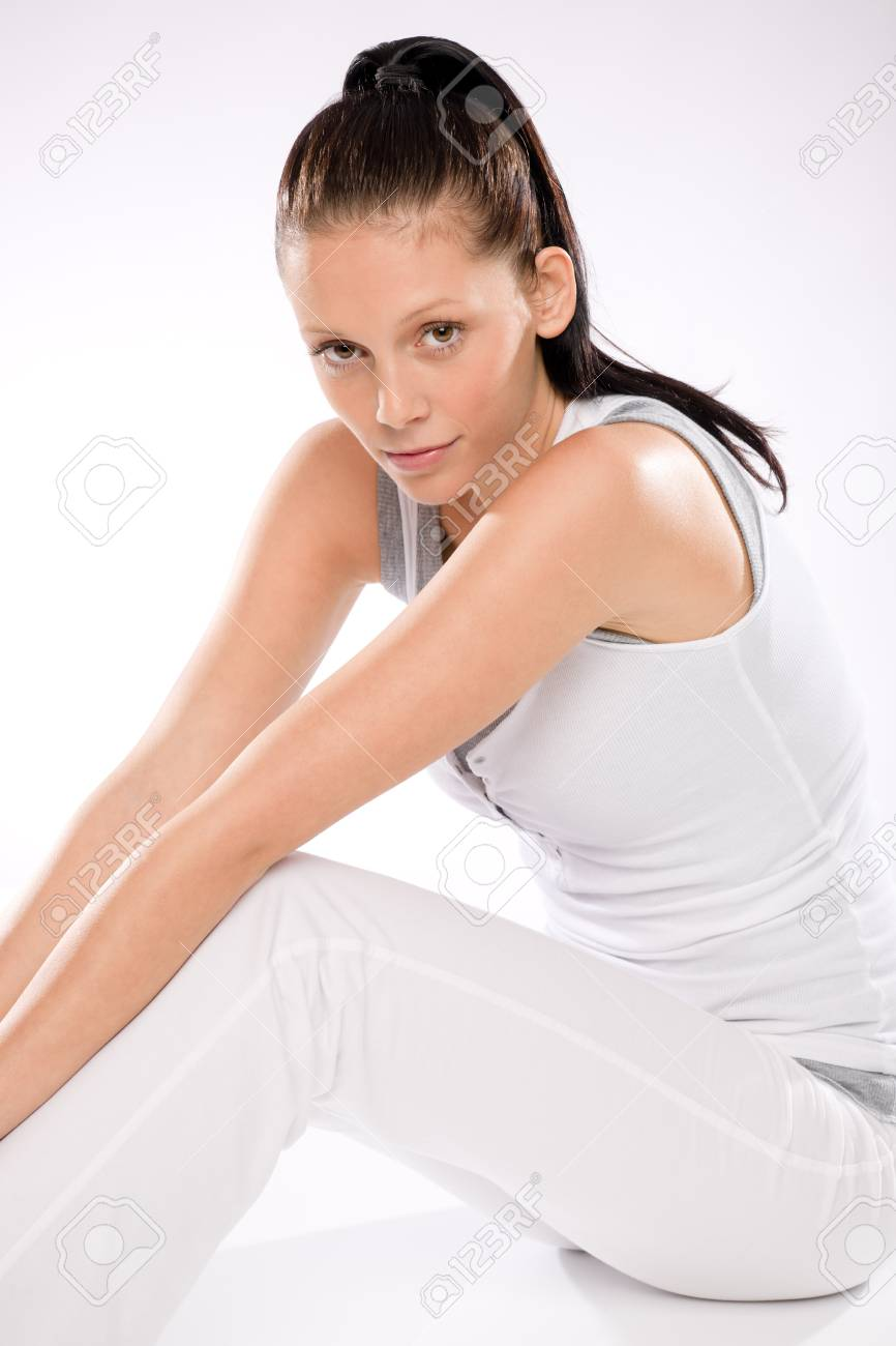 Slim young thirsty woman relaxing after exercising on white background Stock Photo - 17160263