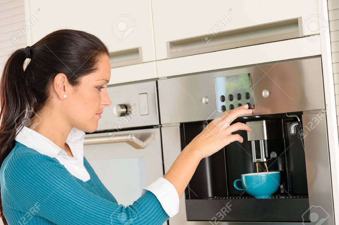 Happy young woman making coffee cup machine kitchen interior Stock Photo - 17388901