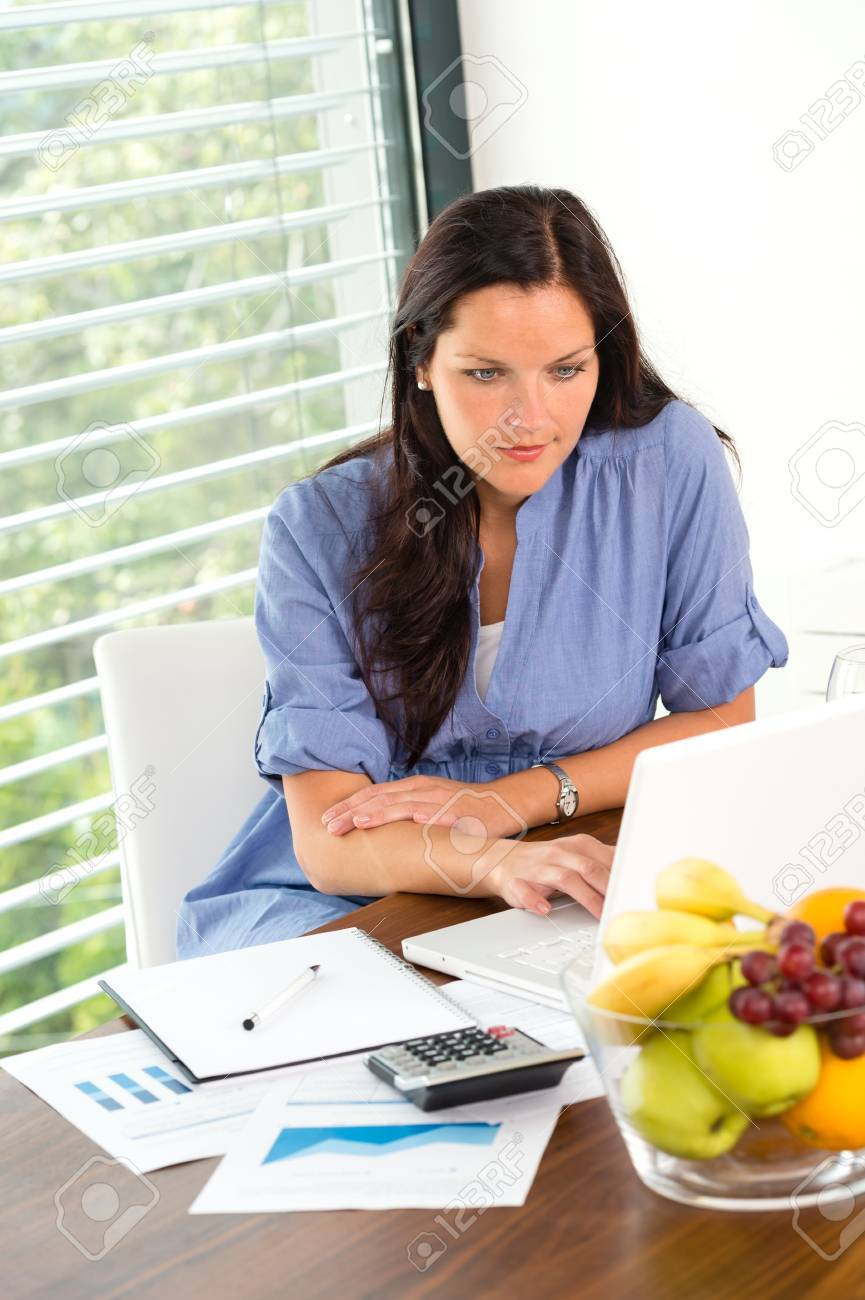 Young woman working using laptop studying office internet business Stock Photo - 17388944