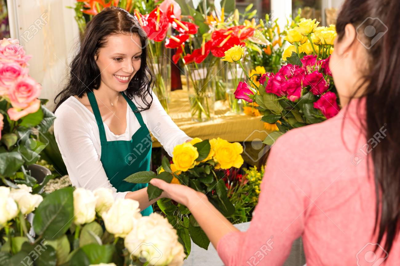 Cheerful flower shop florist customer buying yellow bouquet women Stock Photo - 17692550