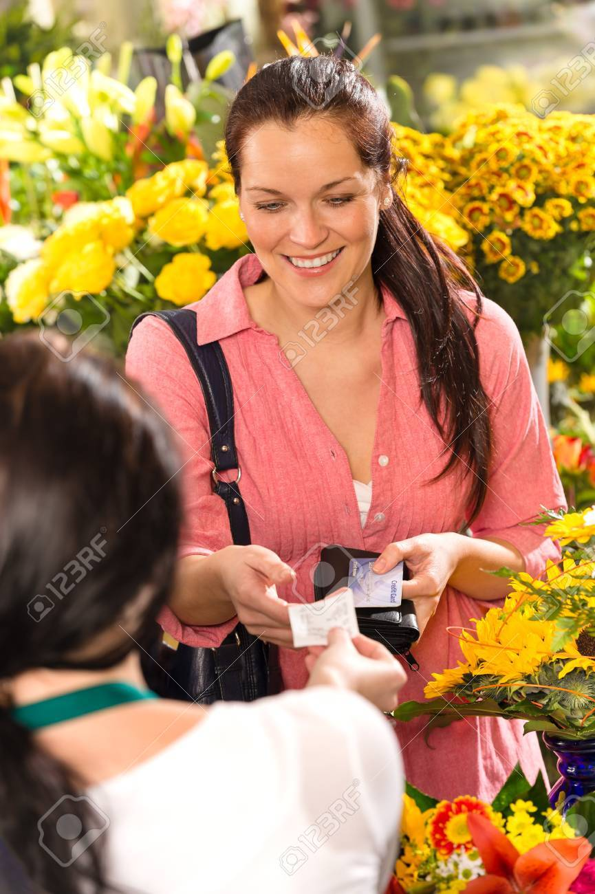 Woman customer taking receipt flower shop buying credit card Stock Photo - 17692461