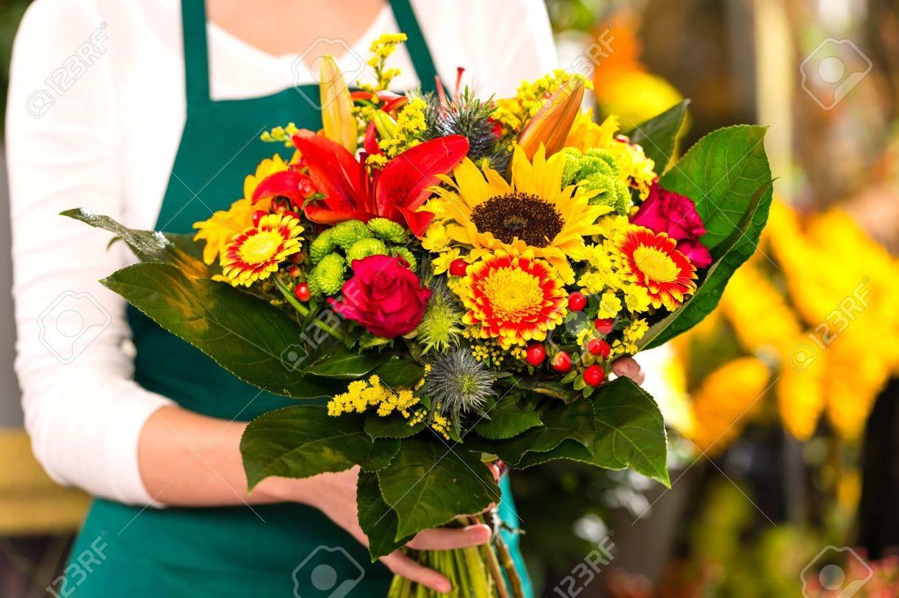Florist holding bouquet colorful flowers shop assistant hands Stock Photo - 17692548
