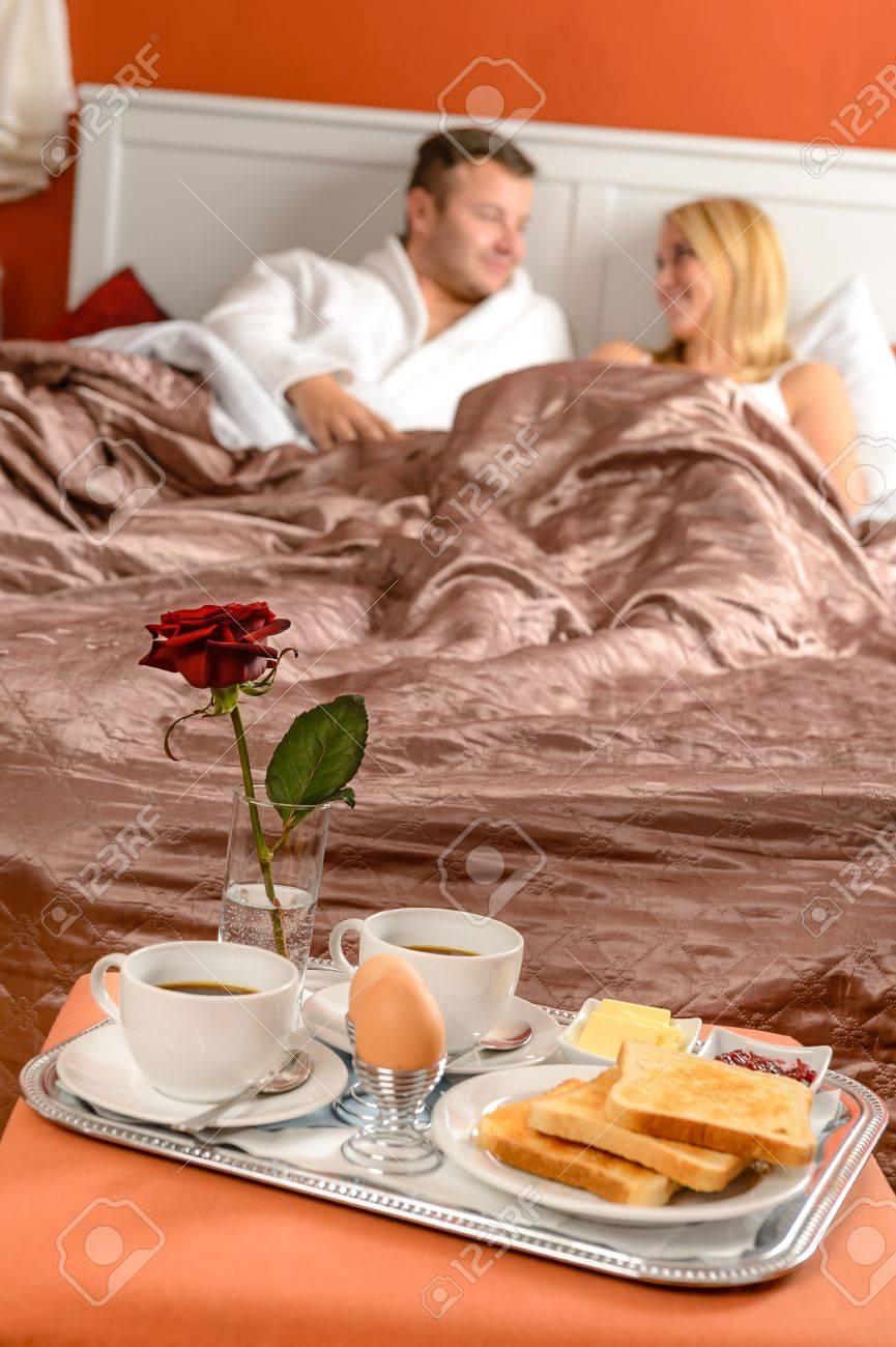 Happy married couple lying bed romantic breakfast hotel Stock Photo - 17887300