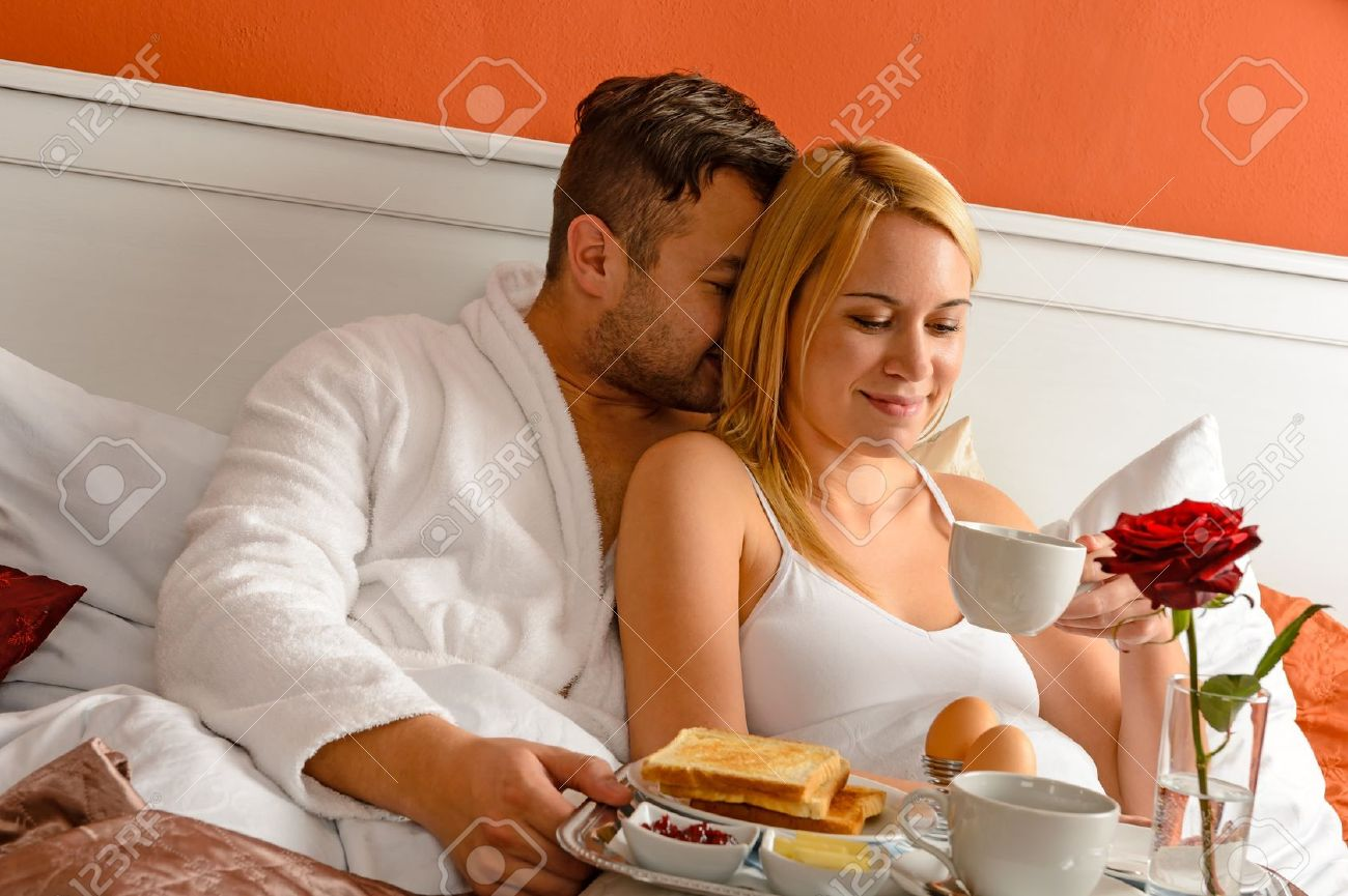 Cuddling young couple romantic morning in bed drinking coffee Stock Photo    17887301. Cuddling Young Couple Romantic Morning In Bed Drinking Coffee