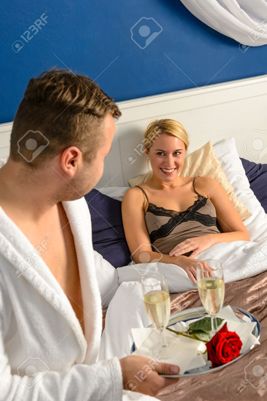 Husband flirting wife bedroom romantic evening celebration sexy nightgown  Stock Photo   17887304. Husband Flirting Wife Bedroom Romantic Evening Celebration Sexy