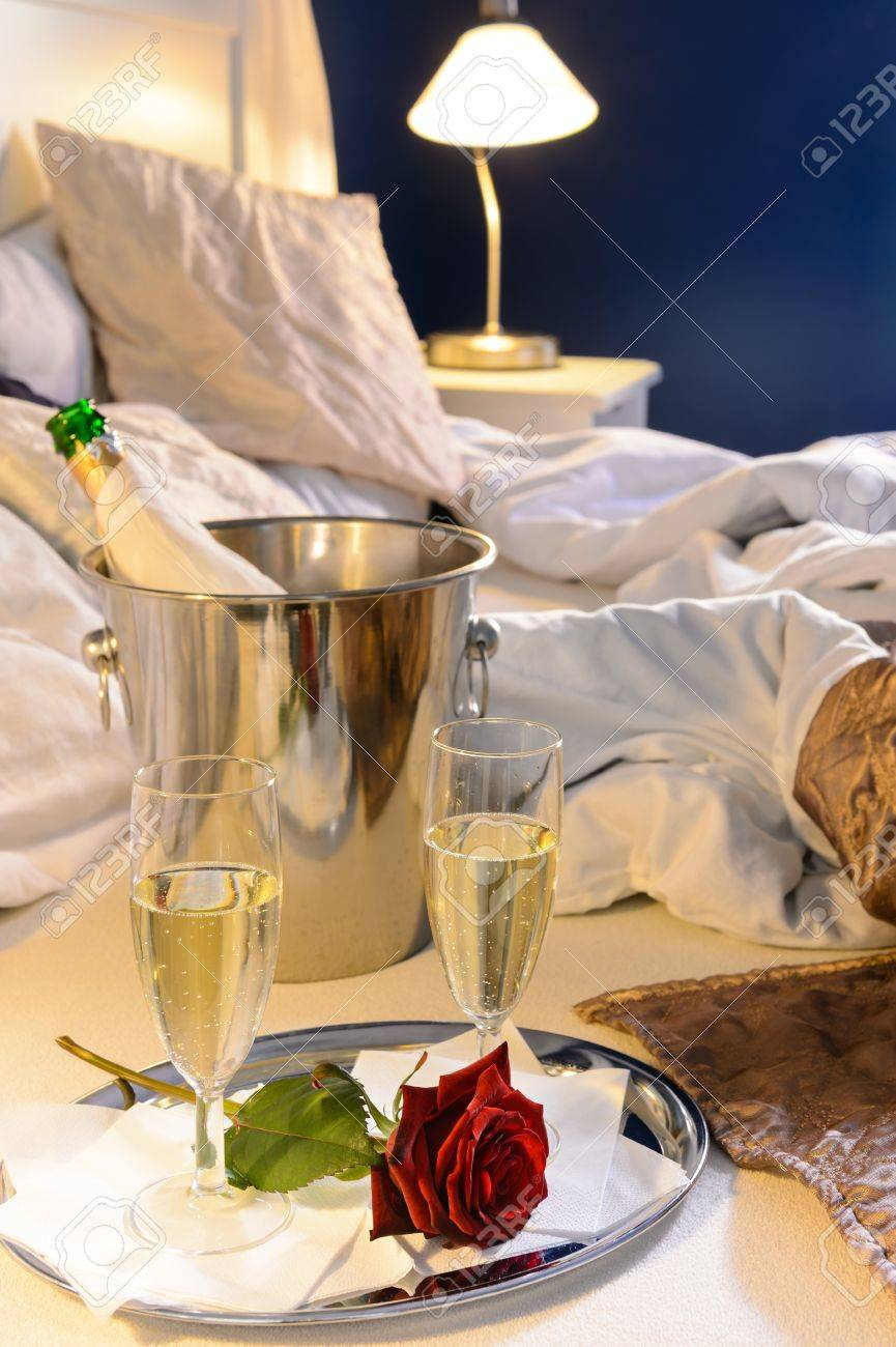 Champagne rose in bed celebrate special occasion hotel bedroom Stock Photo  - 17887294 def263416