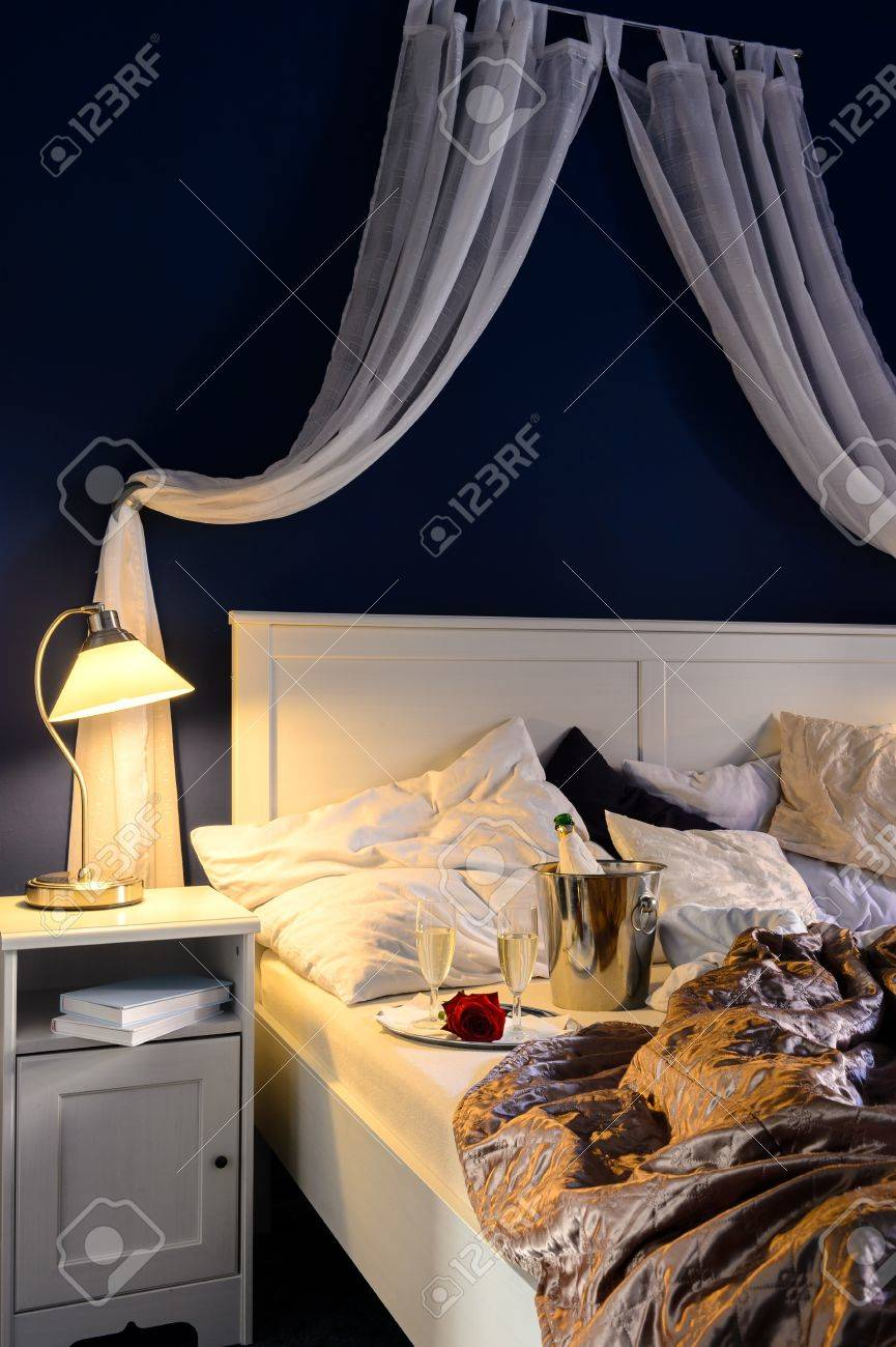 Empty unmade luxury bed romantic feeling with champagne Stock Photo - 17887264
