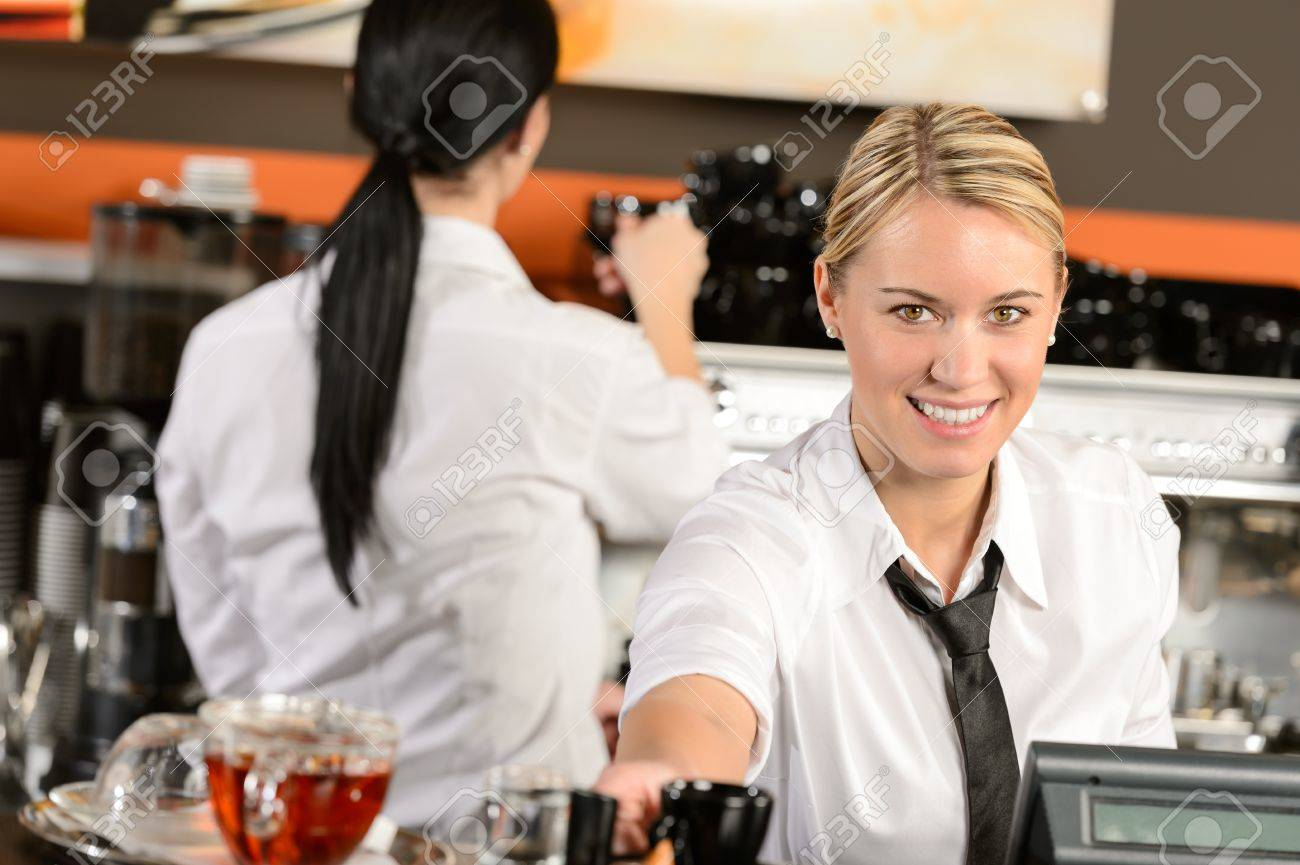 Young happy waitress cashier giving coffee in cafe Stock Photo - 19379838