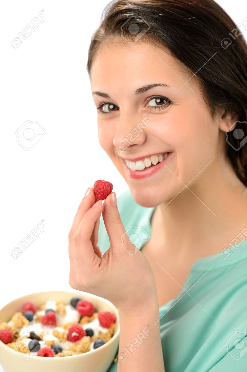 Happy woman with a bowl of healthy cereal and fruits Stock Photo - 19379789