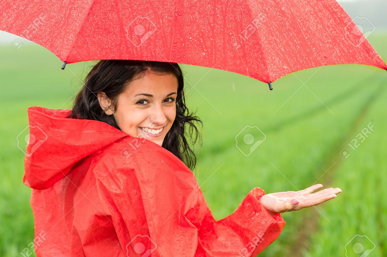 fe2794a9923 Lively teenager girl in the rain looking at camera Stock Photo - 20048667