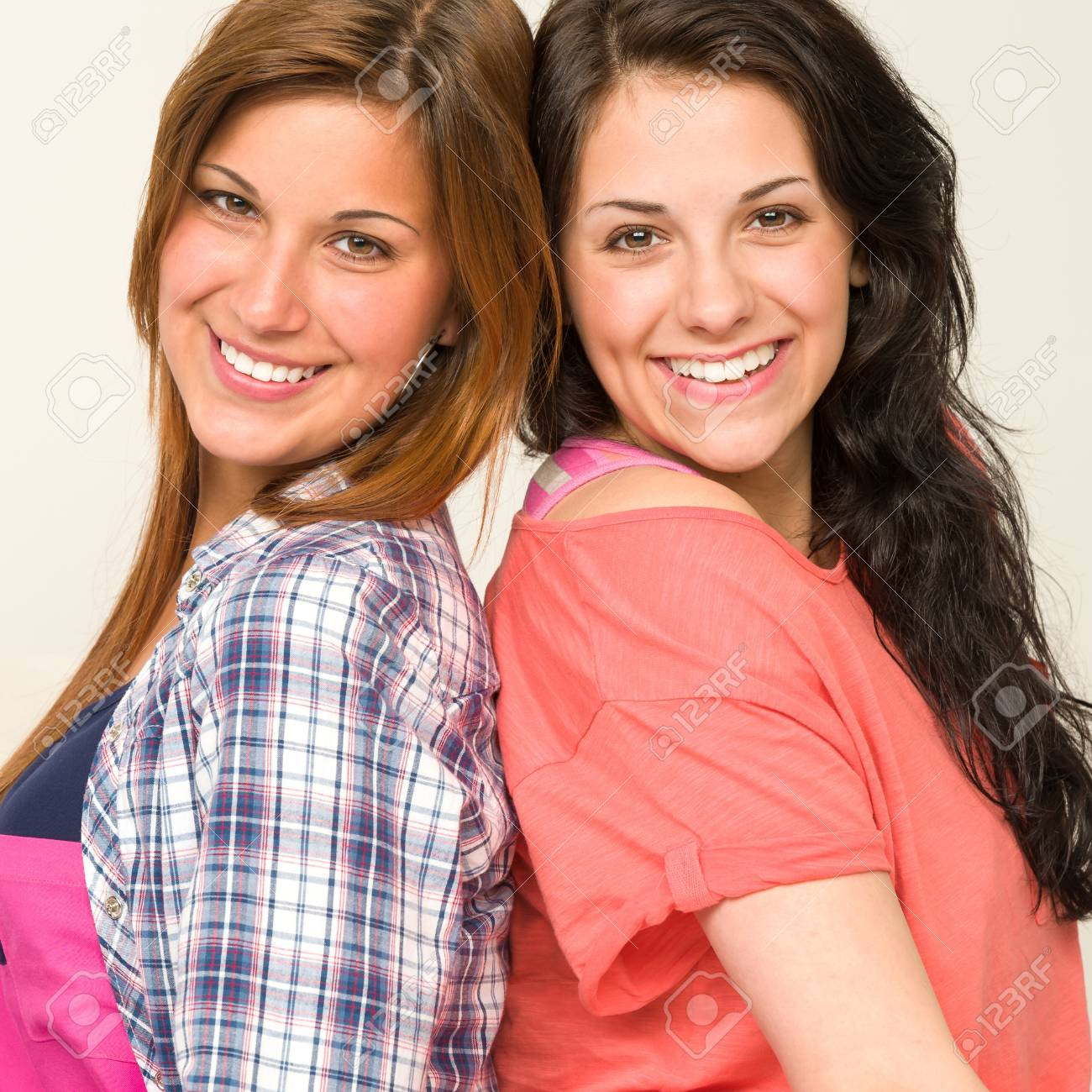 Happy teen sisters friends smiling and looking at camera Stock Photo - 20244529