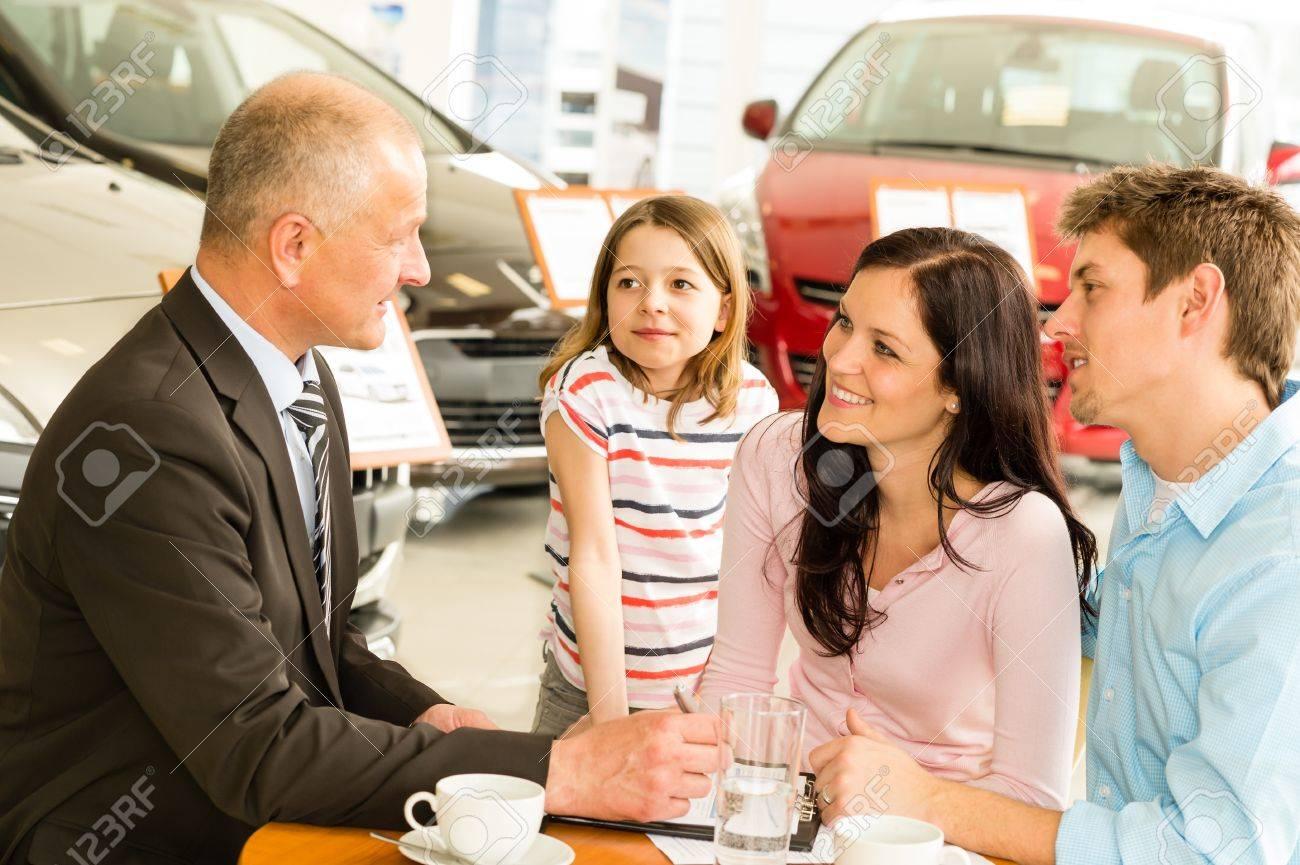 Car salesman and caucasian couple doing paperwork Stock Photo - 21406095