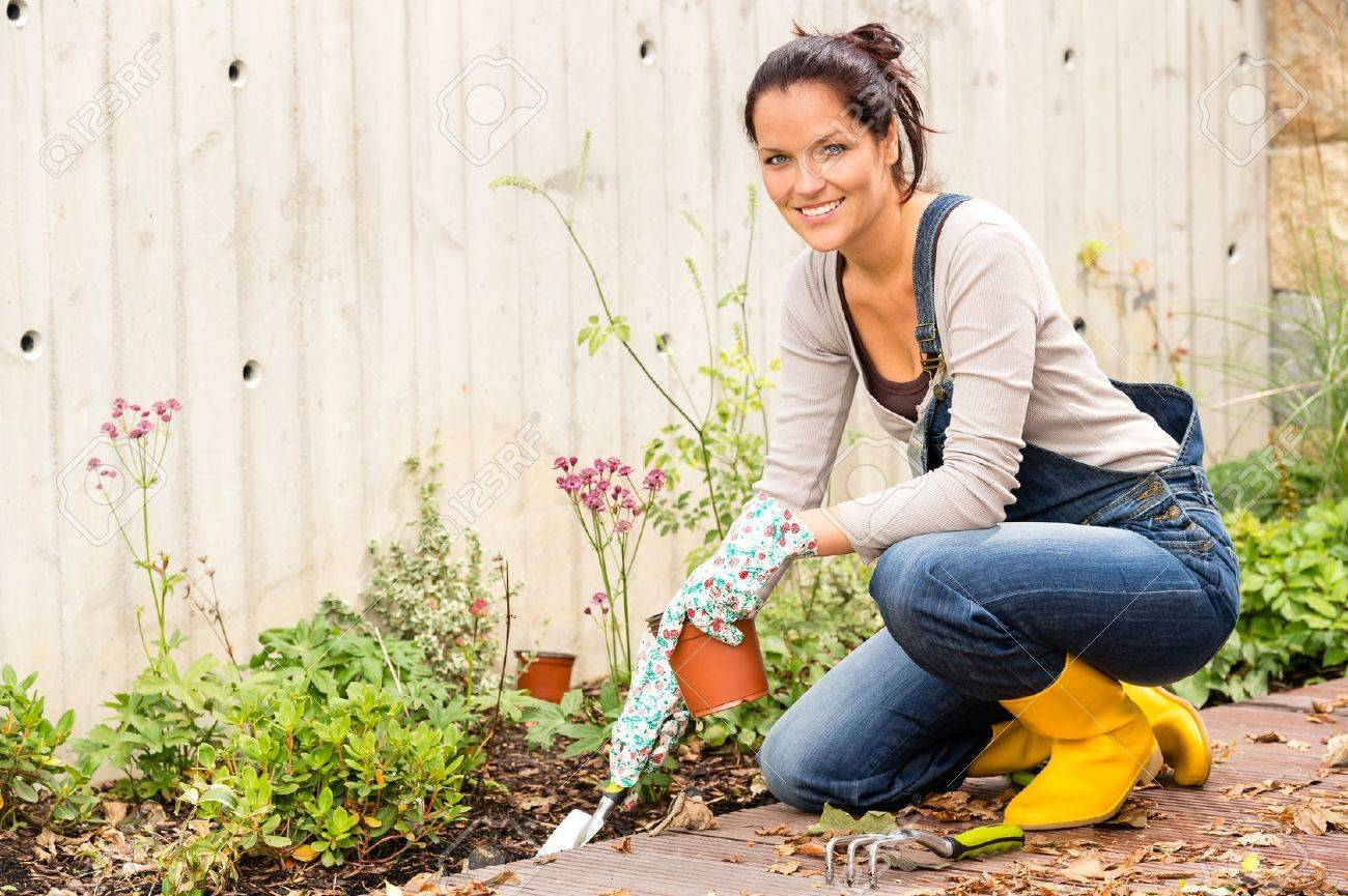 Smiling woman autumn gardening backyard housework hobby Stock Photo - 22062543