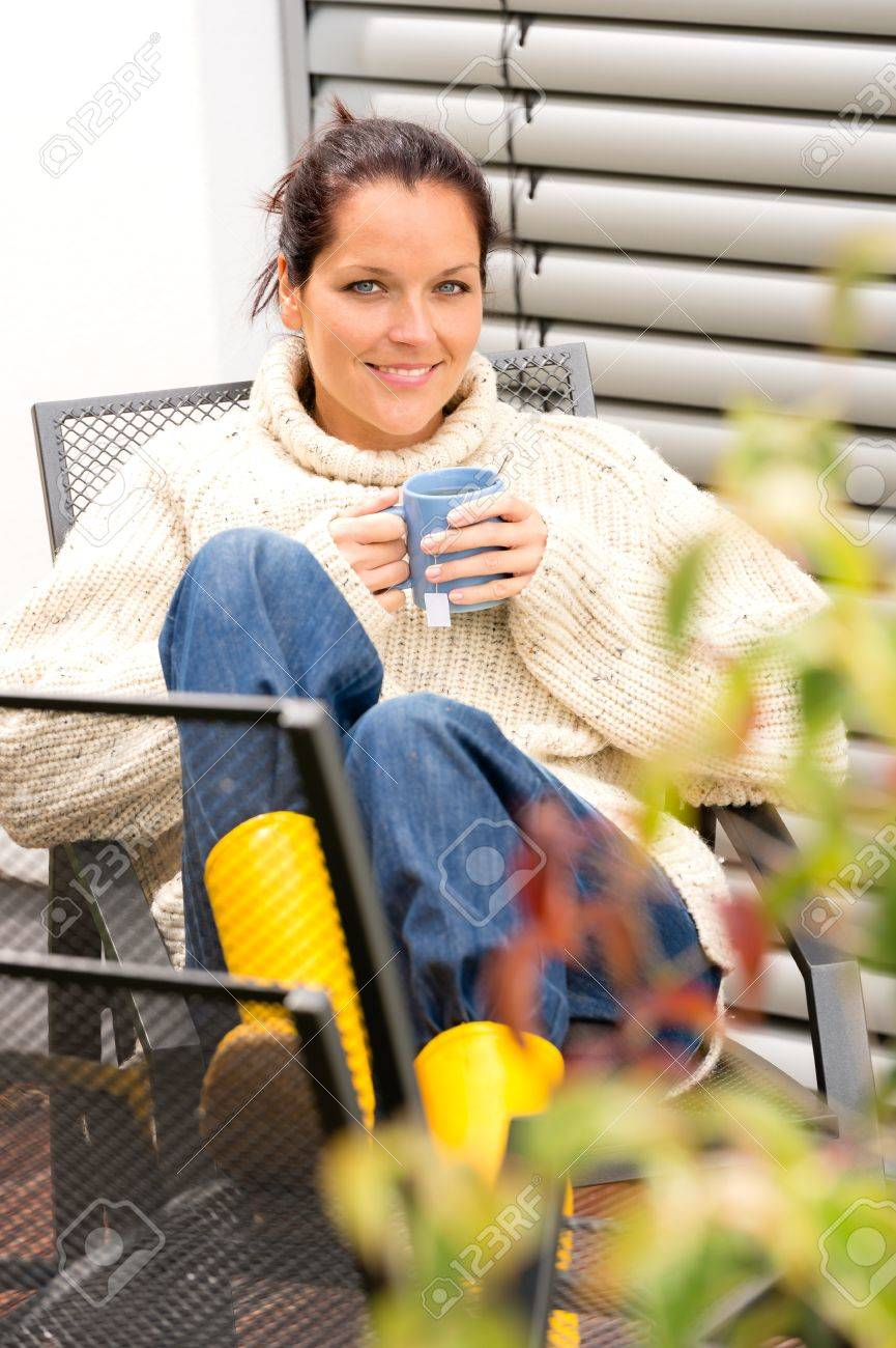 Happy woman autumn relaxing cup hot tea sitting backyard sweater Stock Photo - 22144340