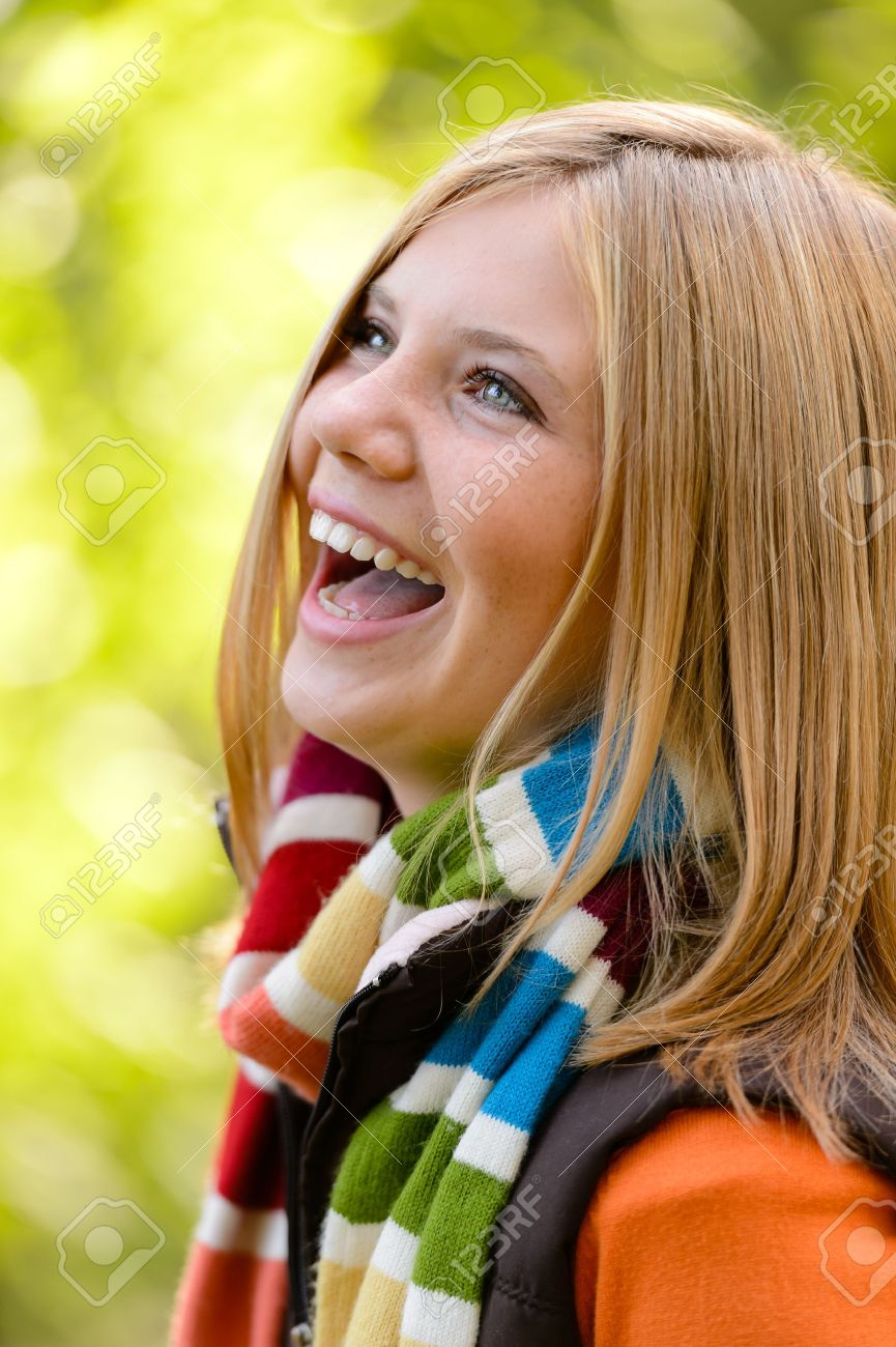 Laughing blonde young girl nature carefree autumn happy Stock Photo - 22126715