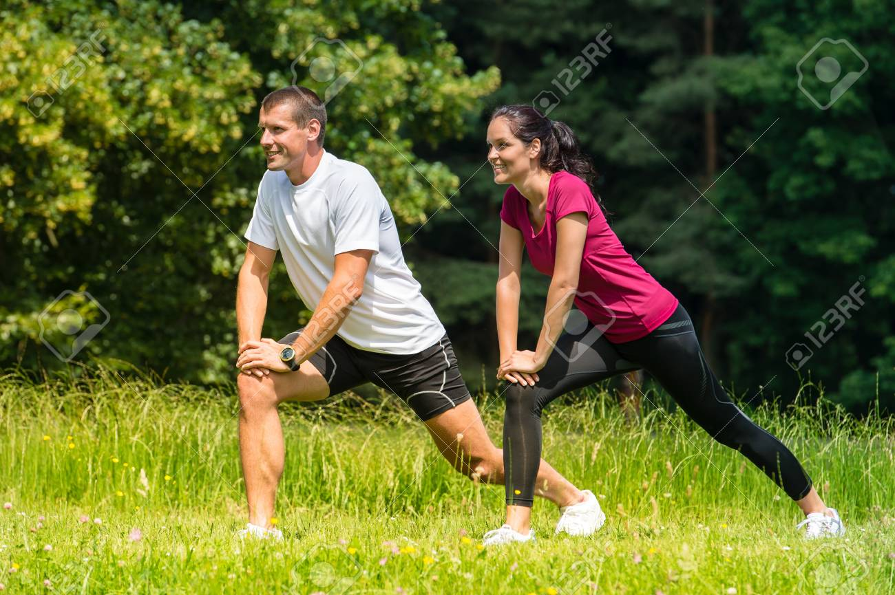 Female and male runner stretching in nature Stock Photo - 22213193