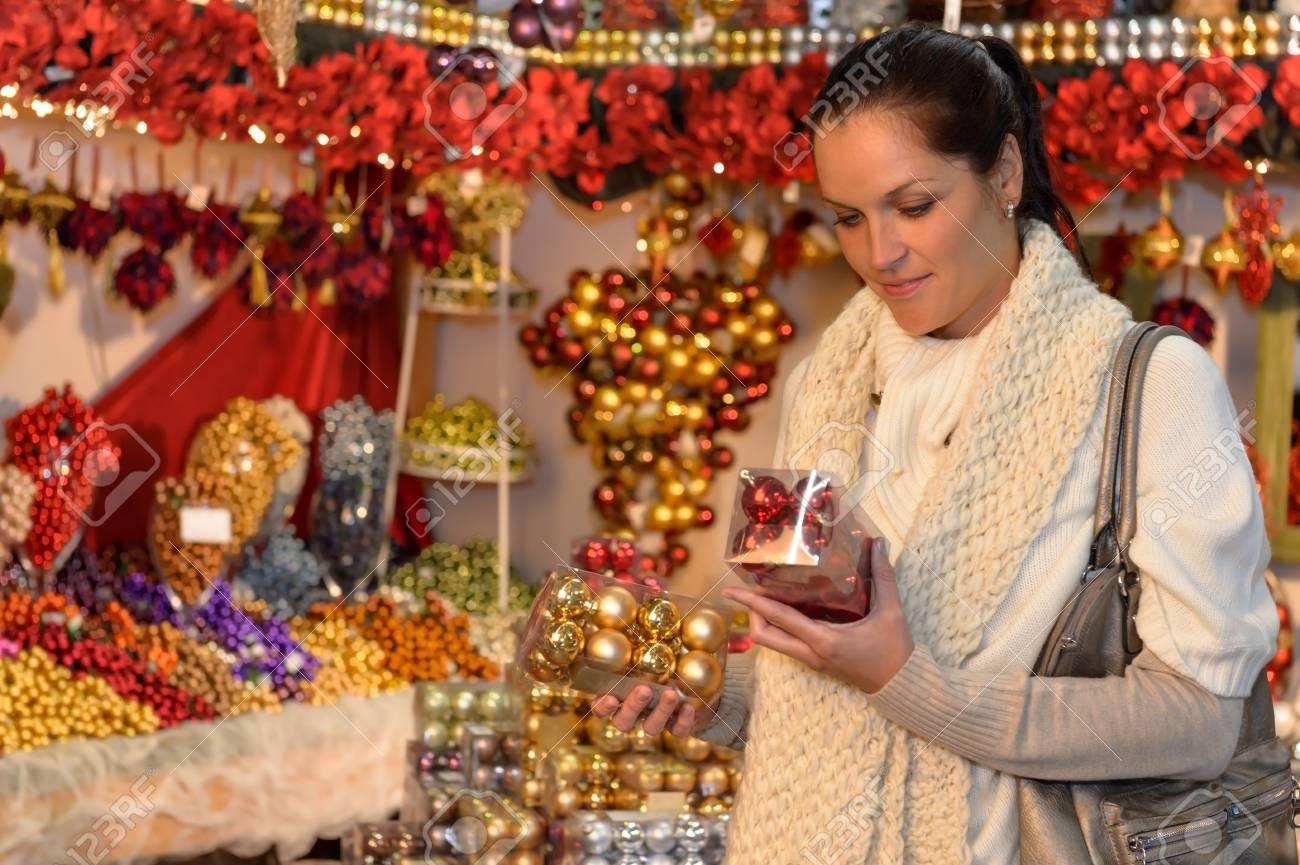 Woman at christmas decoration shop holding boxes of Xmas balls Stock Photo - 22227015