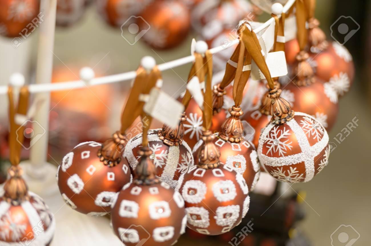 Hanging glittering bronze Christmas decorations bulbs Stock Photo - 22175226