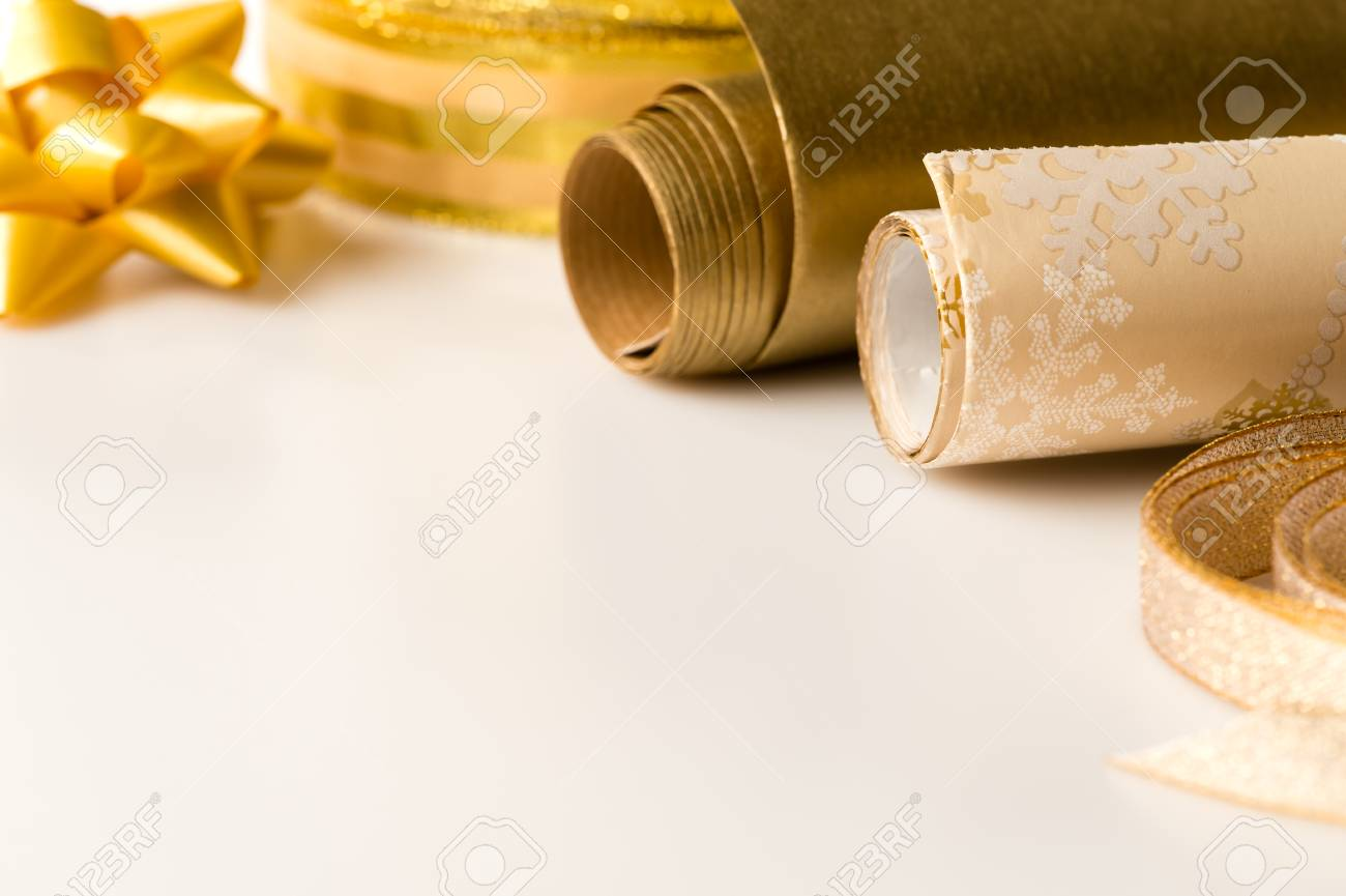 Gold wrapping paper and bow Christmas decoration present Stock Photo - 22396462