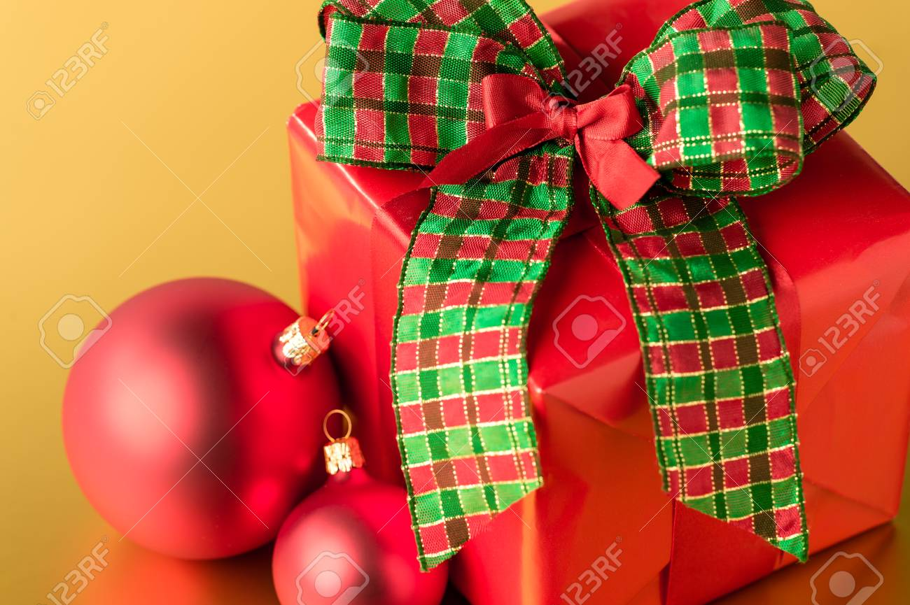 Red Christmas present and decorations big bow gift card Stock Photo - 22396467