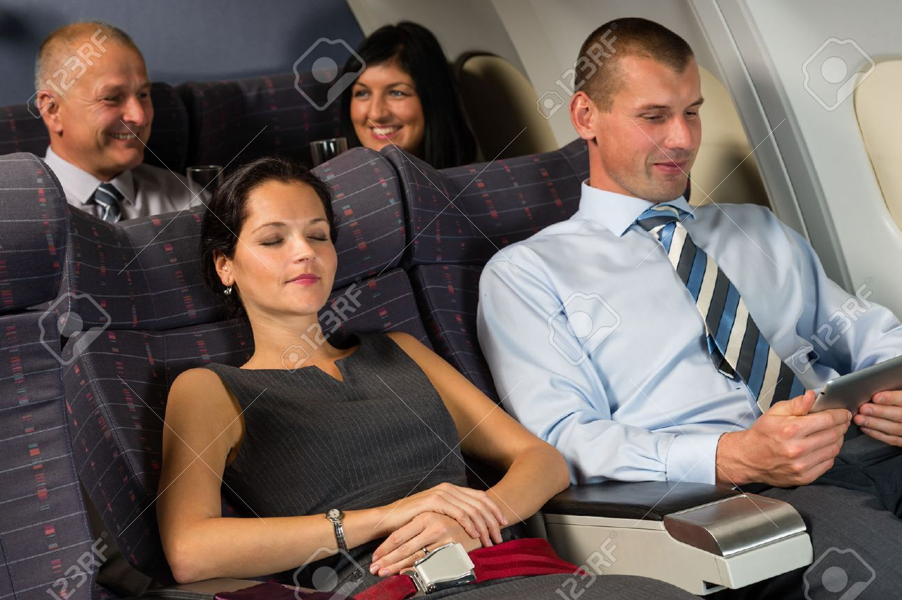 Airplane passengers relax during flight cabin sleep businesspeople Standard-Bild - 23714520
