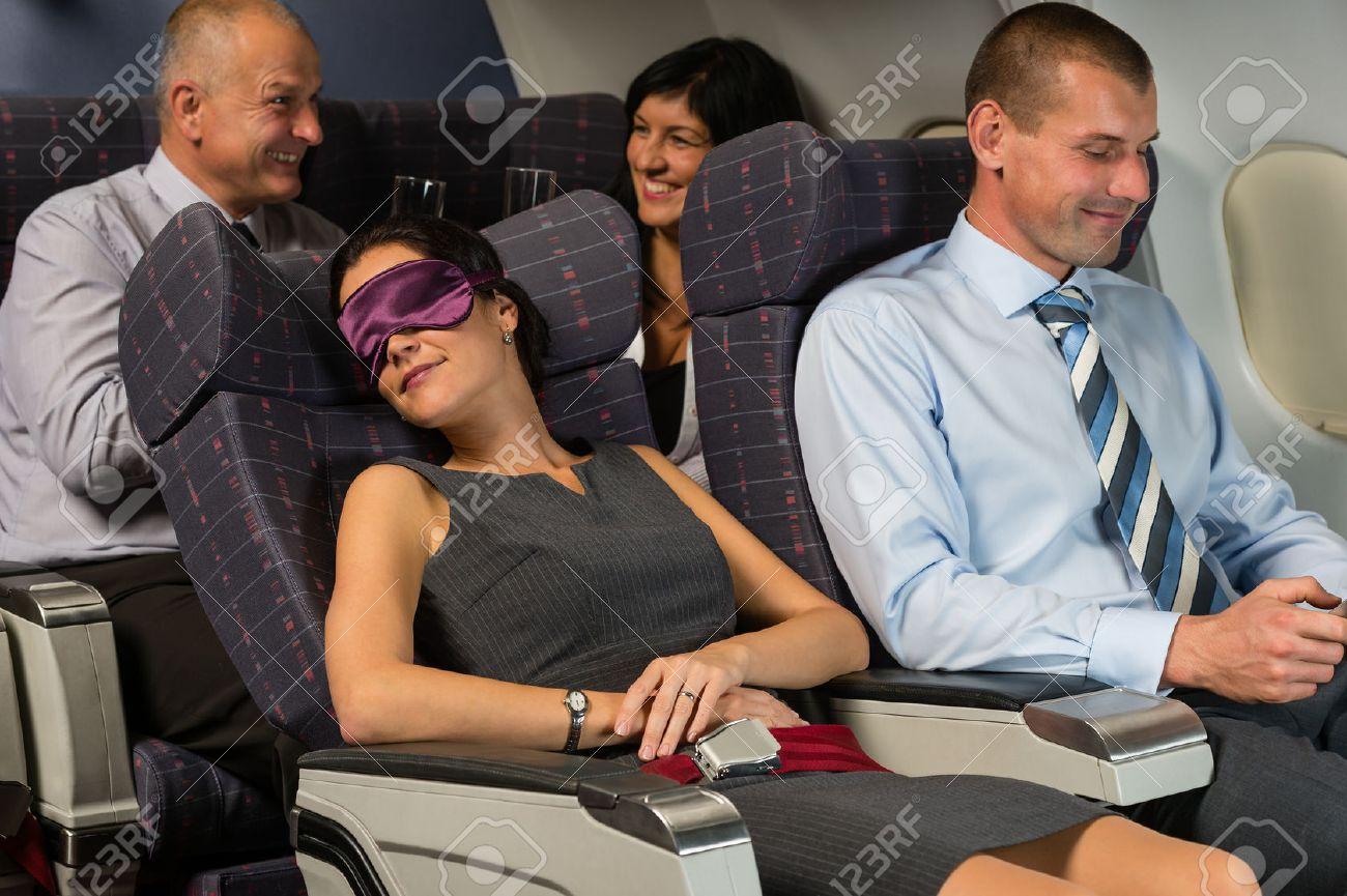 Business woman sleep during night flight airplane cabin passengers Standard-Bild - 23714522