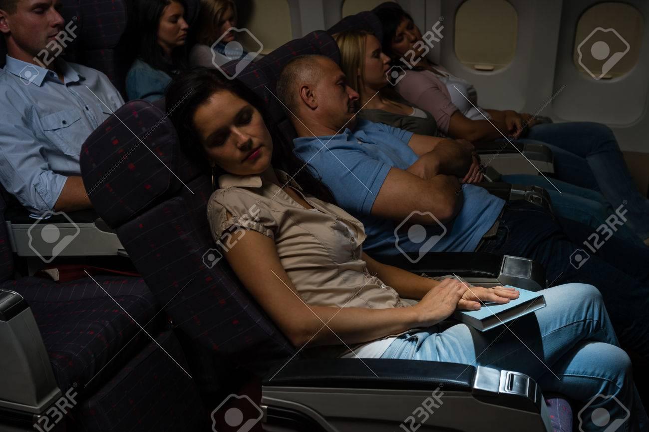 Flight passengers sleeping plane cabin night travel Standard-Bild - 23714529