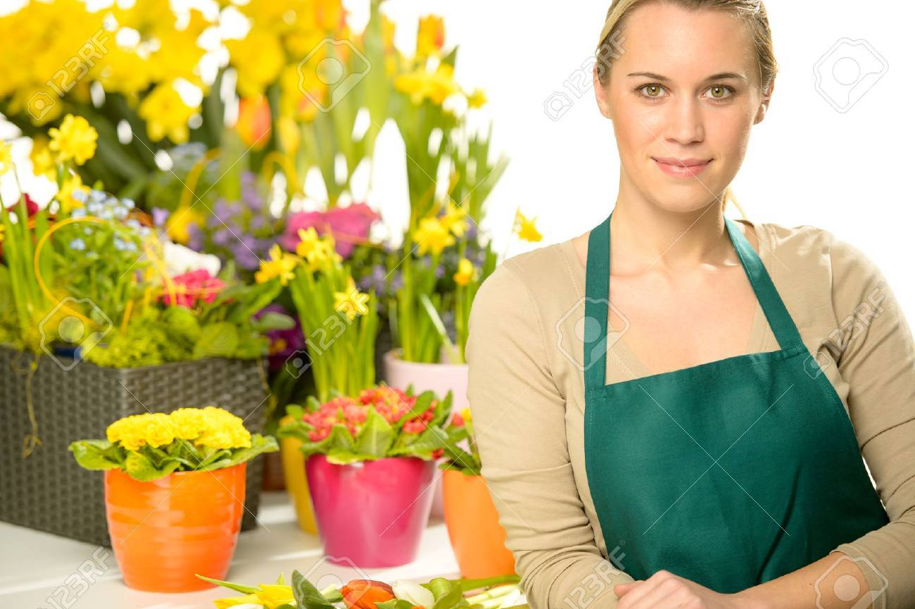 Florist With Spring Potted Flowers Colorful Looking At Camera Stock