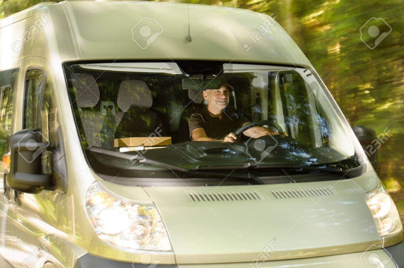 Postal delivery courier man driving cargo van delivering package Stock Photo - 26539485
