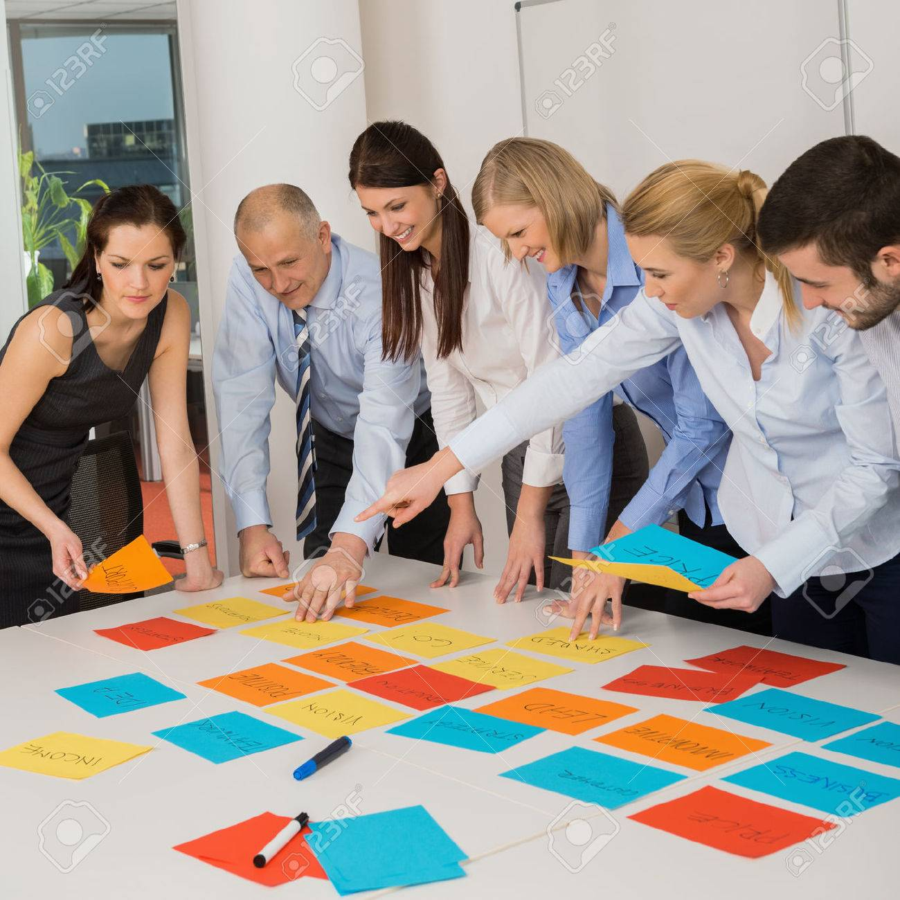 Business team brainstorming using color labels on table in office Stock Photo - 27281137