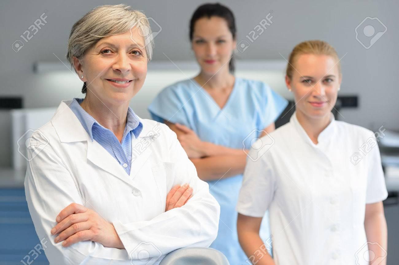 Medical team of three professional woman at dental surgery portrait Standard-Bild - 29952100