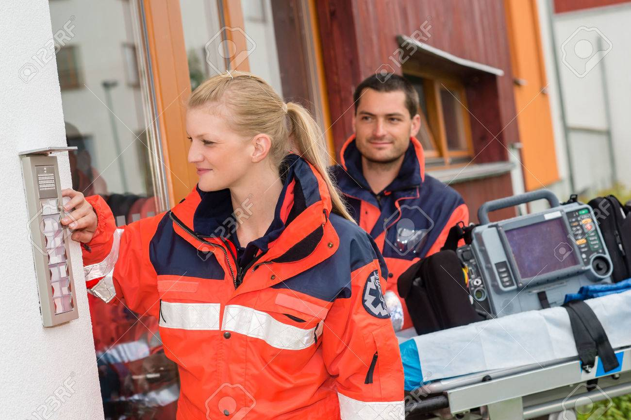 Paramedics house call visit ambulance help ringing woman man assistance Standard-Bild - 30414236