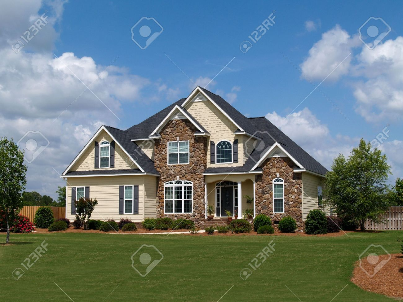 Two story residential home with both stone and board siding on the facade. Stock Photo - 5520067