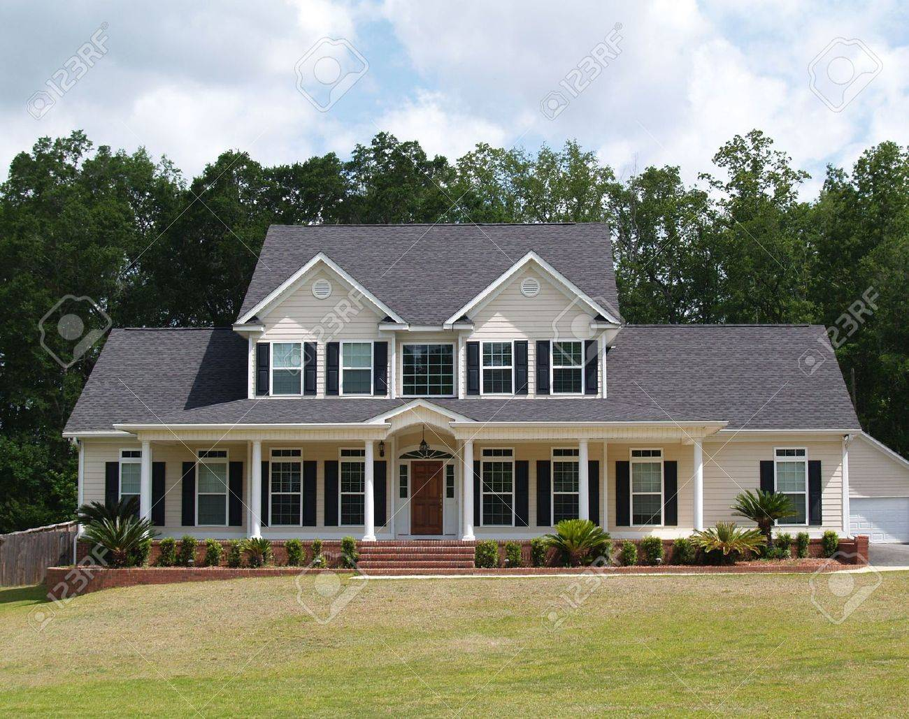Two story residential home with with board siding on the facade. - 5520066