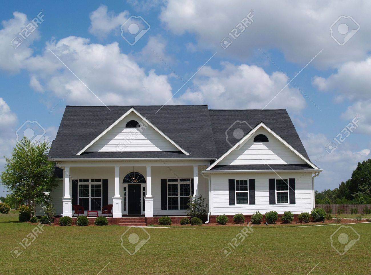 One story residential home with board siding on the facade. - 5520079