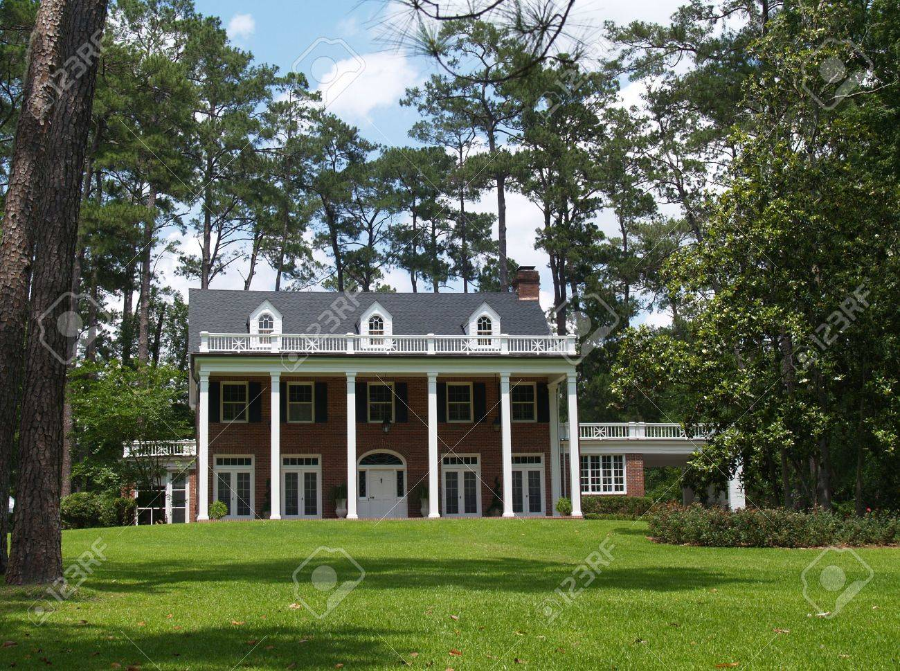 Two story residential, historical, south GA home with brick facade and white columns.Two story residential, historical, south GA home with brick facade and white columns.Two story residential, historical, south GA home with brick facade and white colum - 5608251