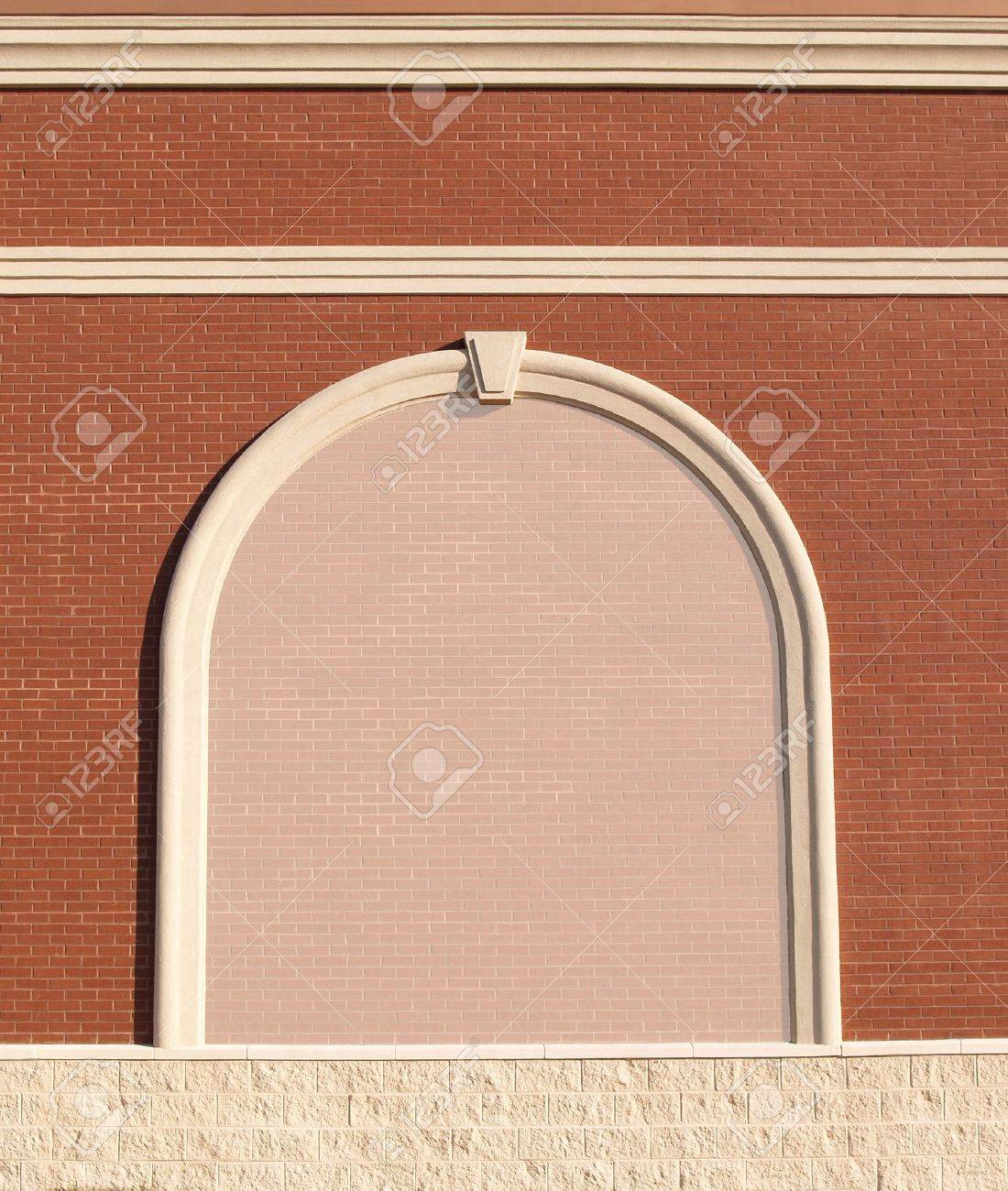Ornate Roman styled brick wall with curved molding and a reduced opacity brick copy space. - 5228817
