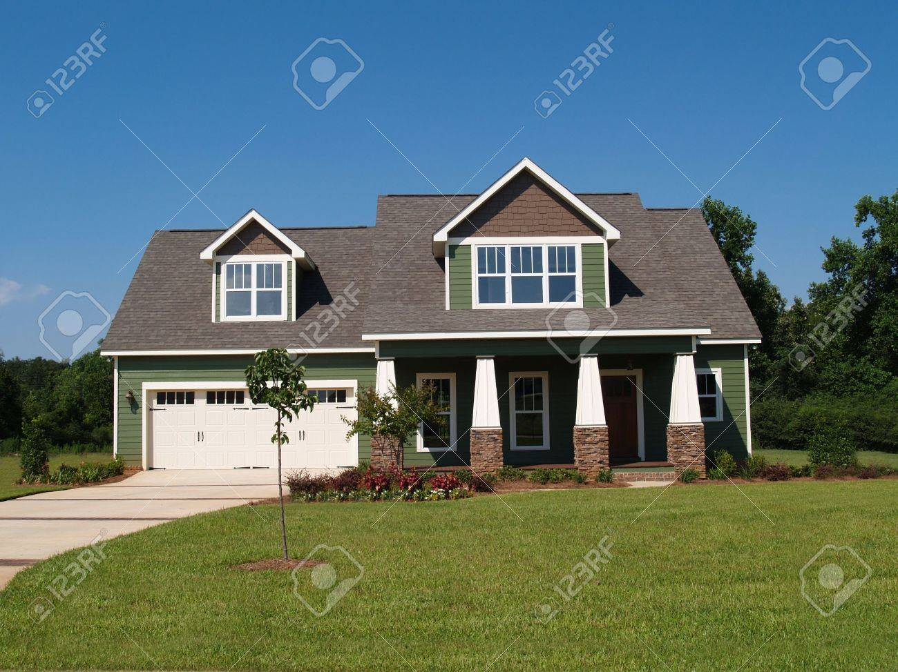 Two story residential home board siding on the facade. - 5520113