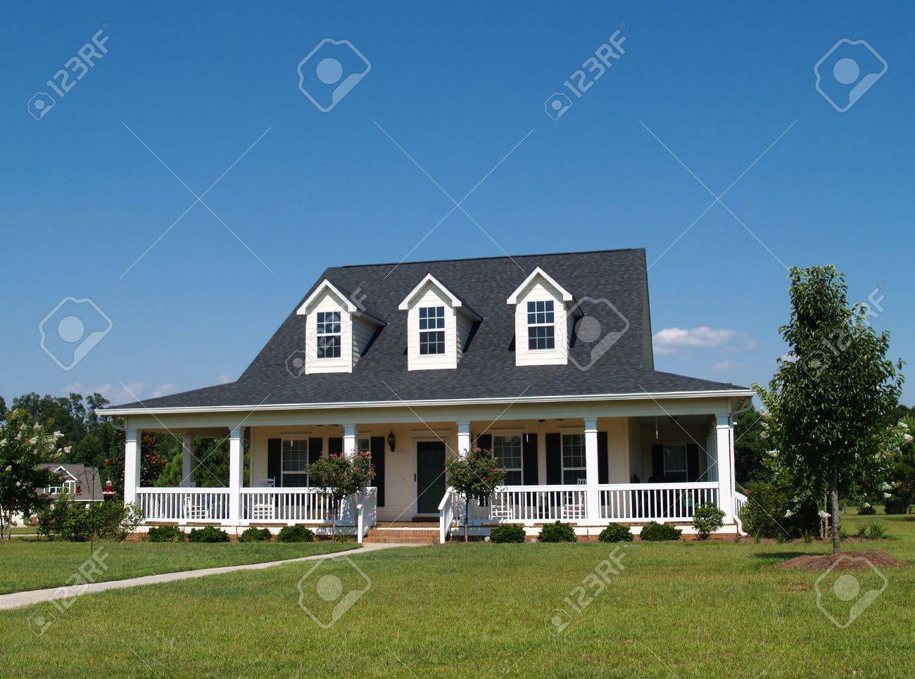 Two story residential home with vinyl or board siding on the facade. - 5520096